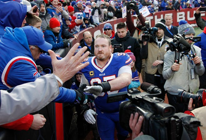 Buffalo Bills defensive tackle Kyle Williams greets fans after an NFL football game against the Miami Dolphins, Sunday, Dec. 30, 2018, in Orchard Park, N.Y. The Bills won 42-17. (AP Photo/Jeffrey T. Barnes)