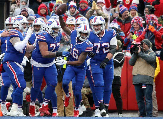 Robert Foster (16) of the Buffalo Bills celebrates his touchdown in the third quarter during a win over the Miami Dolphins on Dec. 30.