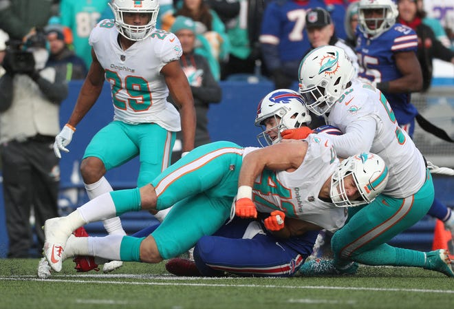 Miami's Kiko Alonso was ejected for this hit on Bills quarterback Josh Allen  who slid after a long run.