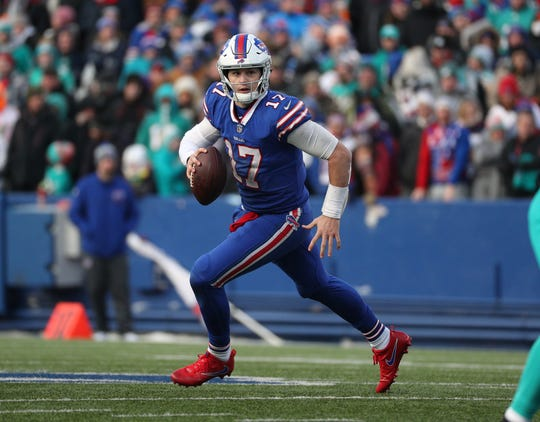 Buffalo Bills quarterback Josh Allen rolls outside of the pocket during a Dec. 30, 2019, win over the Miami Dolphins at New Era Field in Orchard Park.