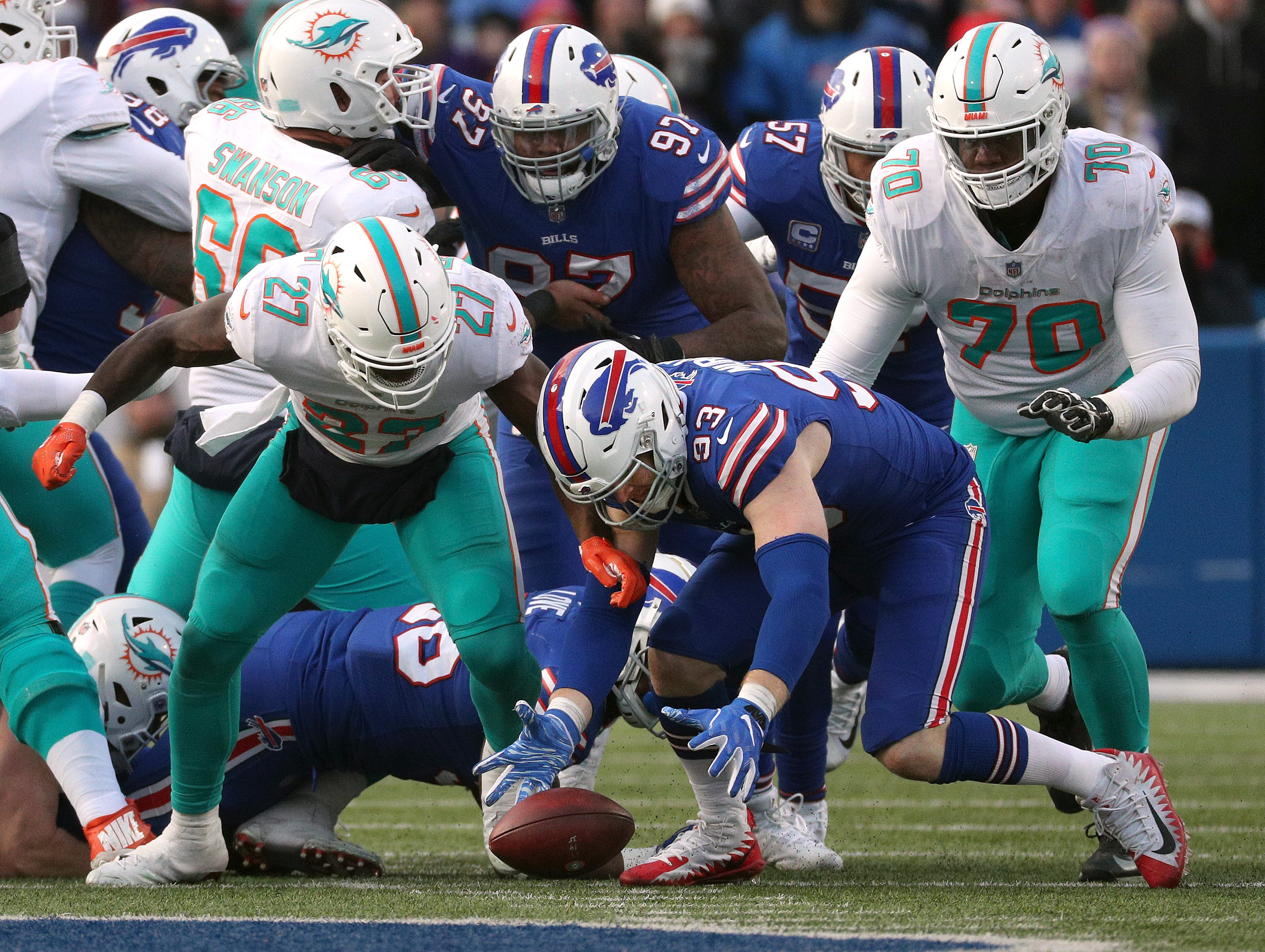 Bills Trent Murphy recovers a fumble by Miami's Kalen Ballage.
