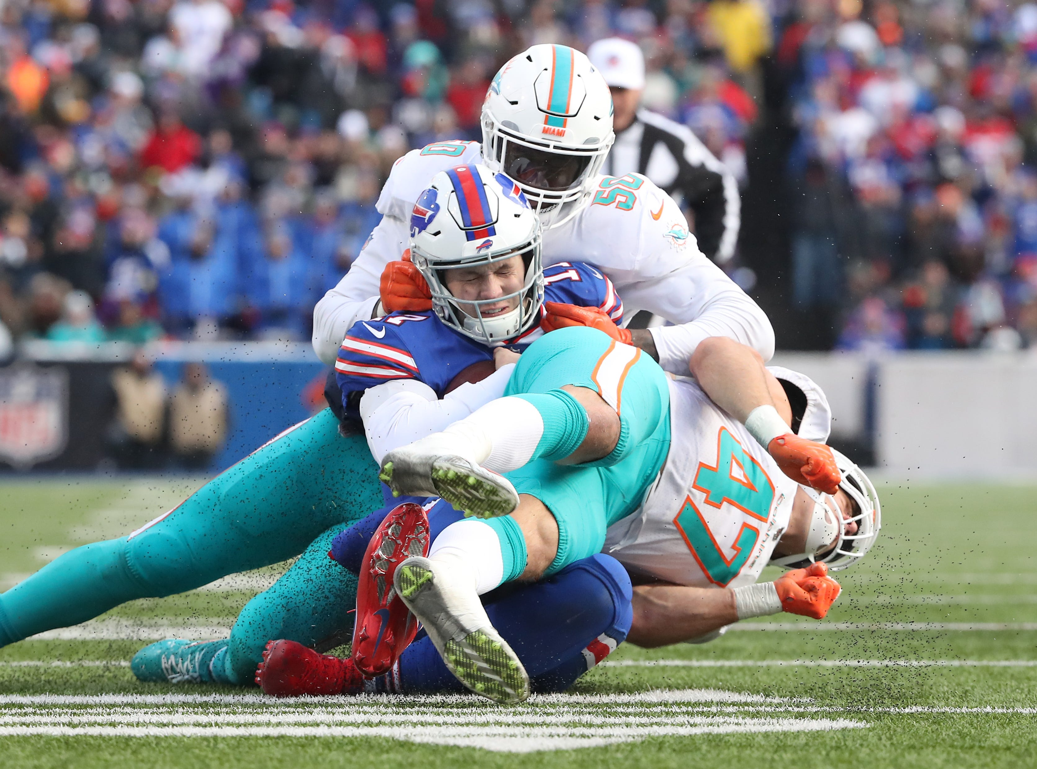 BUFFALO, NY - DECEMBER 30: Josh Allen #17 of the Buffalo Bills takes a late hit from Kiko Alonso #47 of the Miami Dolphins in the third quarter resulting in an unnecessary roughness penalty and a game ejection during NFL game action at New Era Field on December 30, 2018 in Buffalo, New York. (Photo by Tom Szczerbowski/Getty Images)