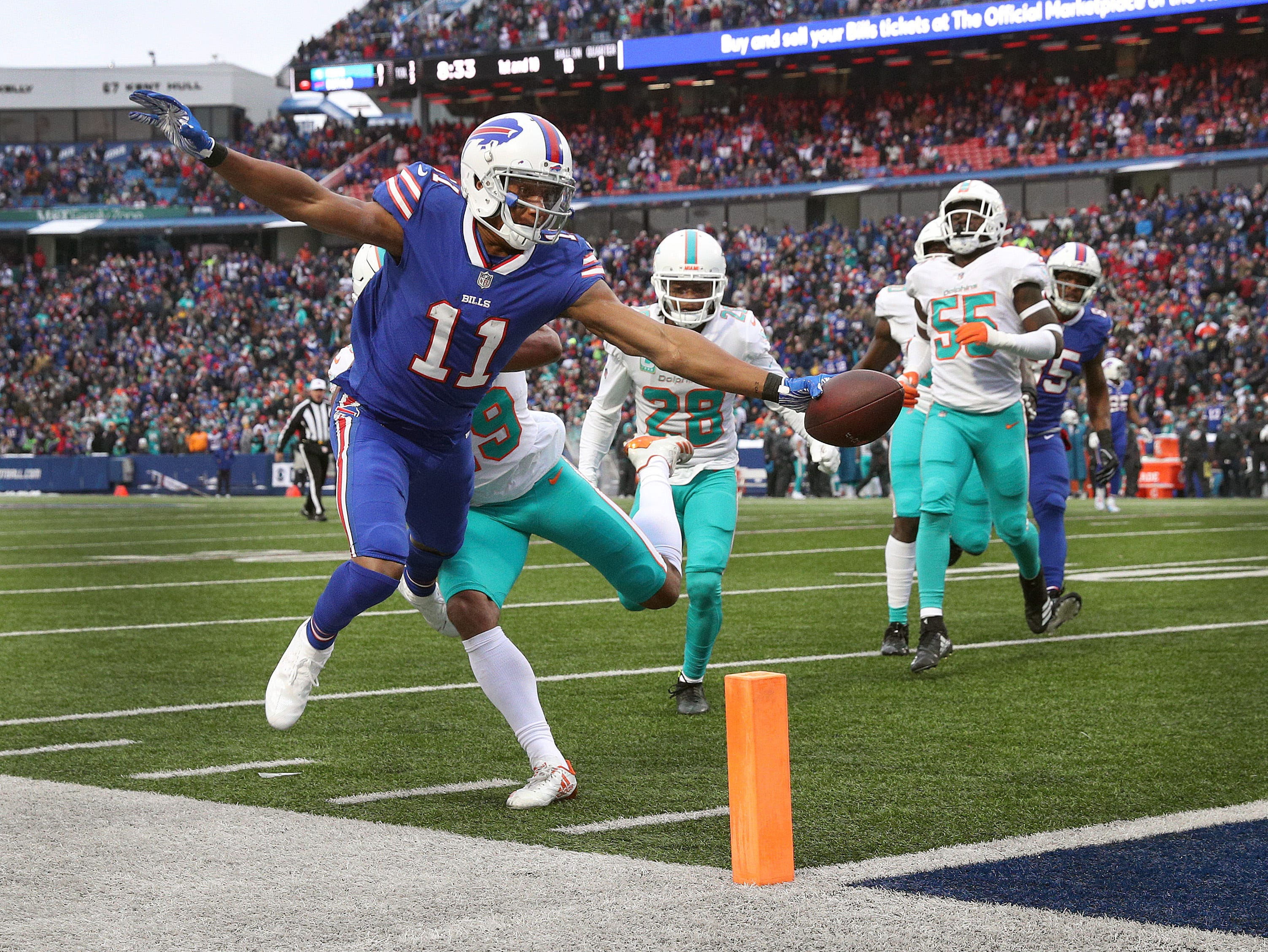 Bill receiver Zay Jones pokes the ball into the end zone for 18-yard touchdown reception.  The Bills beat the Dolphins 42-17.