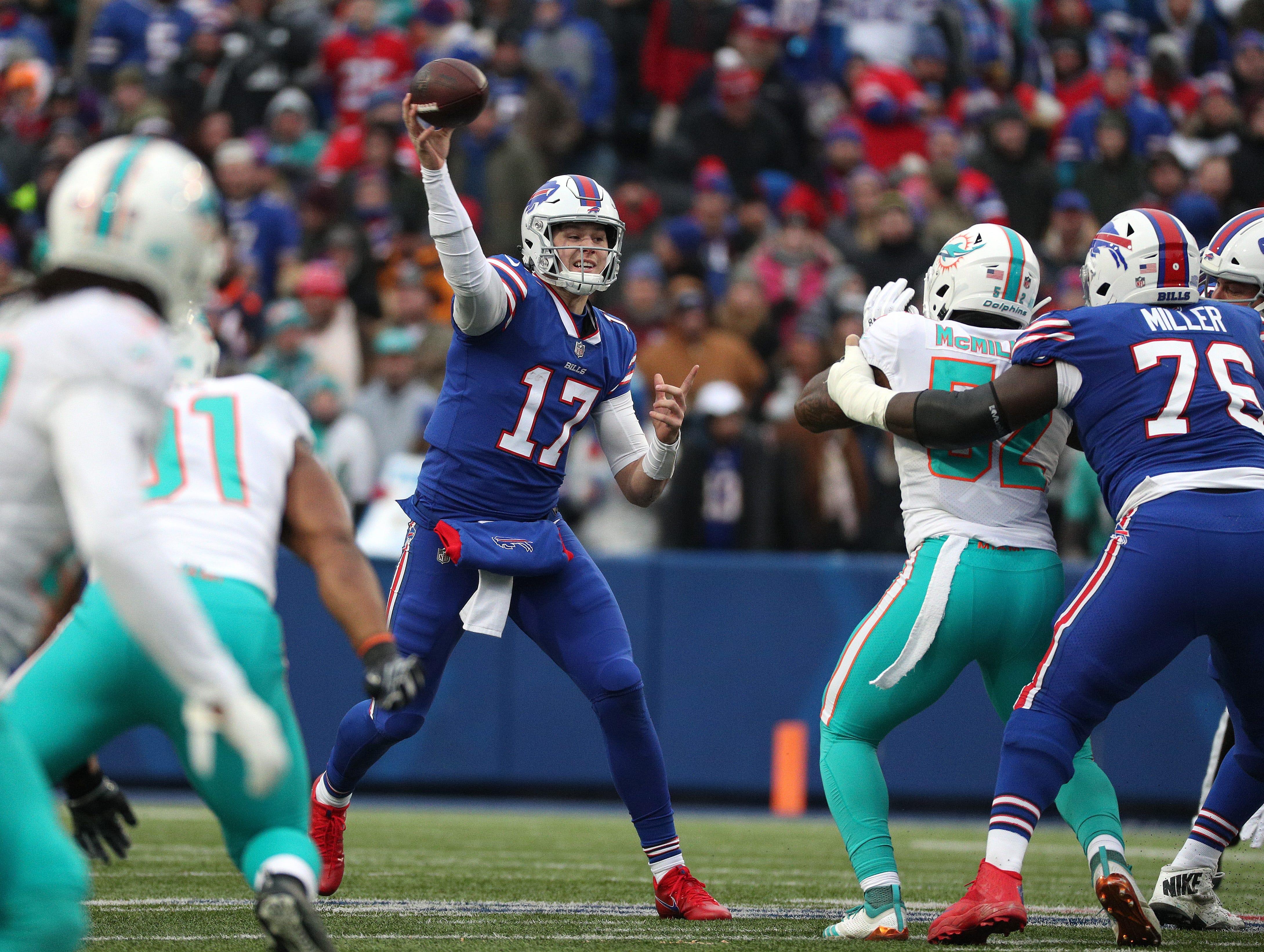 Bills quarterback Josh Allen steps into a throw against Miami.