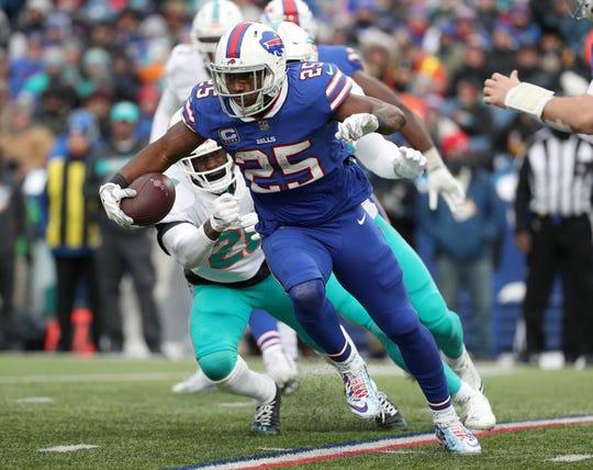 Bills running back LeSean McCoy looks for running room against Miami.