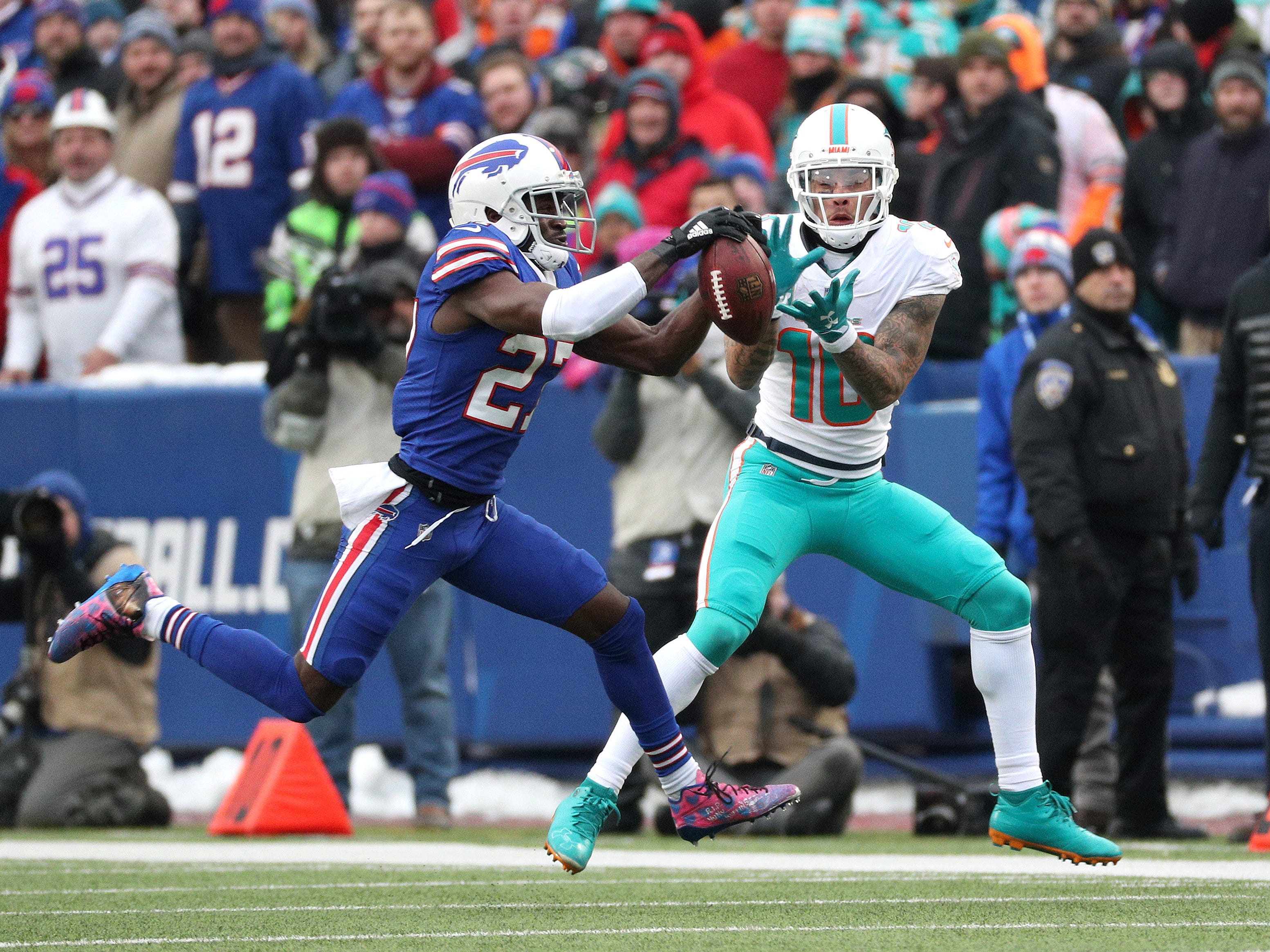 Bills cornerback Tre'Davious White intercepts a pass intended for Dolphins receiver Kenny Stills during Sunday's season finale at New Era Field.