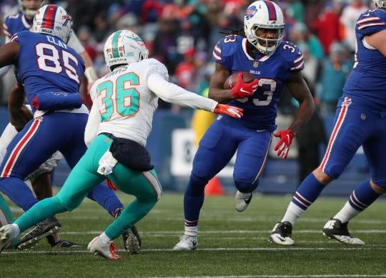 Bills running back Chris Ivory looks for running room during the season finale against Miami. The Bills released Ivory on Wednesday.