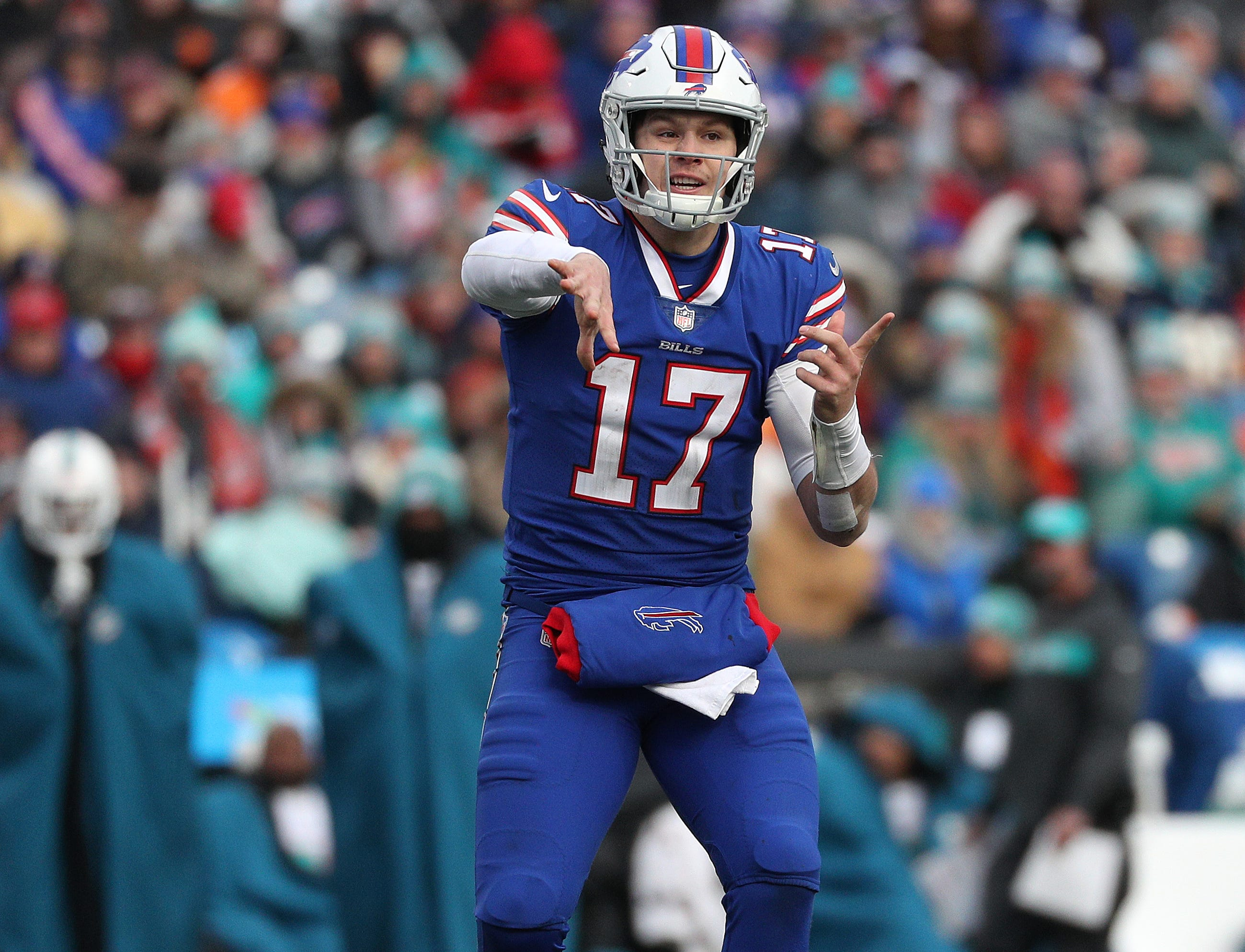 Bills quarterback Josh Allen  dumps off a shot pass over the middle.