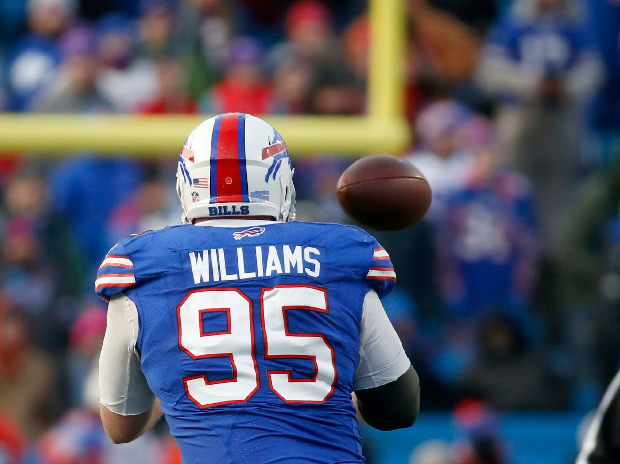 Dec 30, 2018; Orchard Park, NY, USA; Buffalo Bills defensive tackle Kyle Williams (95) makes a catch during the second half against the Miami Dolphins at New Era Field. Mandatory Credit: Timothy T. Ludwig-USA TODAY Sports