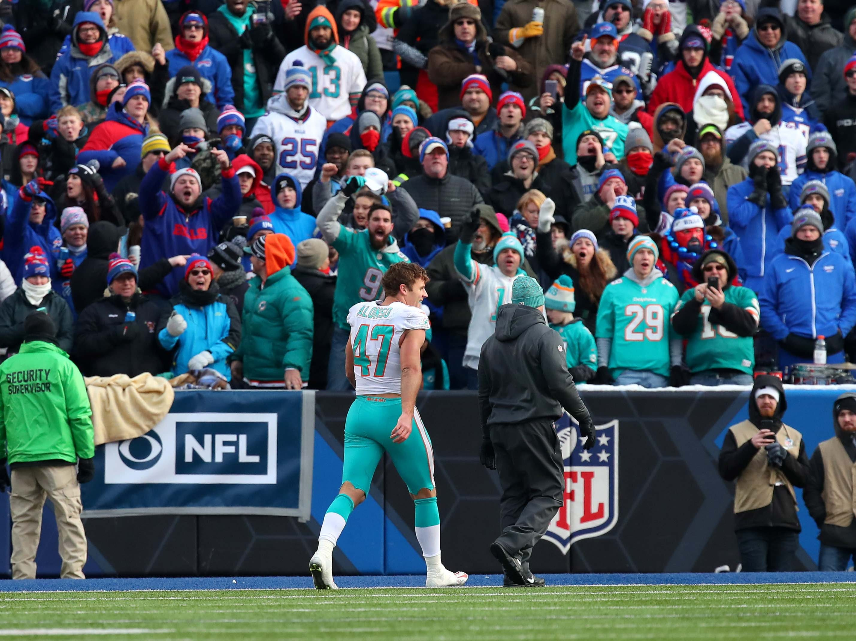 Dec 30, 2018; Orchard Park, NY, USA; Miami Dolphins outside linebacker Kiko Alonso (47) leaves the field after being ejected against the Buffalo Bills during the third quarter at New Era Field. Mandatory Credit: Rich Barnes-USA TODAY Sports