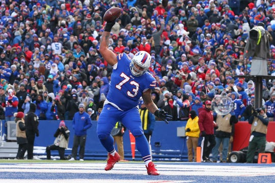 Buffalo Bills offensive tackle Dion Dawkins (73) spikes the ball after a touchdown run by running back LeSean McCoy (not pictured) against the Miami Dolphins Sunday at New Era Field.