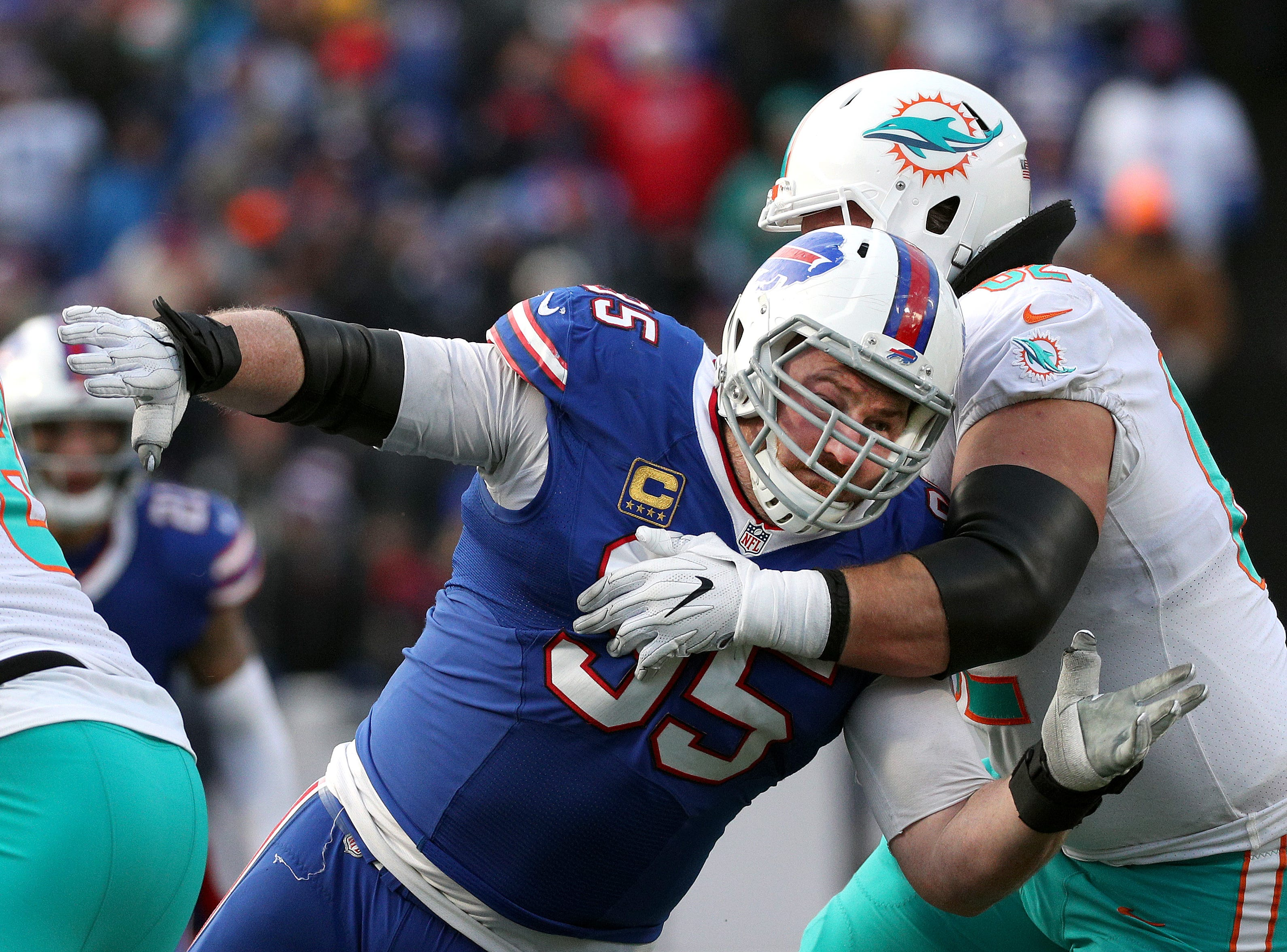 Bills defensive tackle Kyle Williams fight f=though a block.