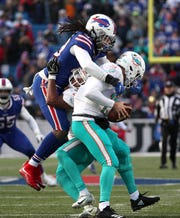 Bills linebacker Tremaine Edmunds jumps over Miami blocker Kenyan Drake and sacks quarterback Ryan Tannehill. The Bills beat the Dolphins 42-17.