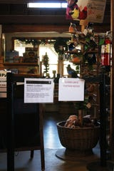Half the store in Pinnacles is sectioned off from the public, closed due to the shutdown. Among the items no longer for sale are commemorative patches, postcards, and maps of the park.