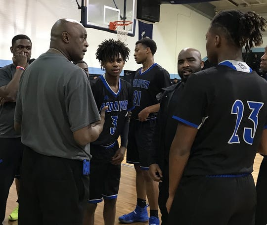 """Red River coach Keith Johnson talks to his team, including Emareyon McDonald (3) during the 2018 """"Doc"""" Edwards Invitational."""