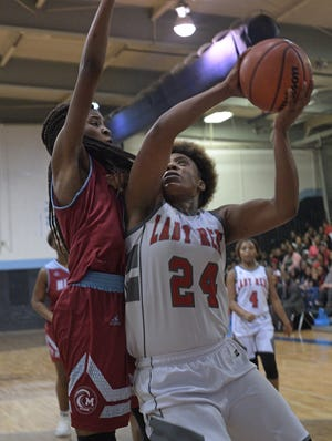 """North Caddo's Destiny Rice battles Minden's Bre Rodgers during Saturday's 2018 """"Doc"""" Edwards girls final. The two seniors combined to score 76 points in the double overtime game."""