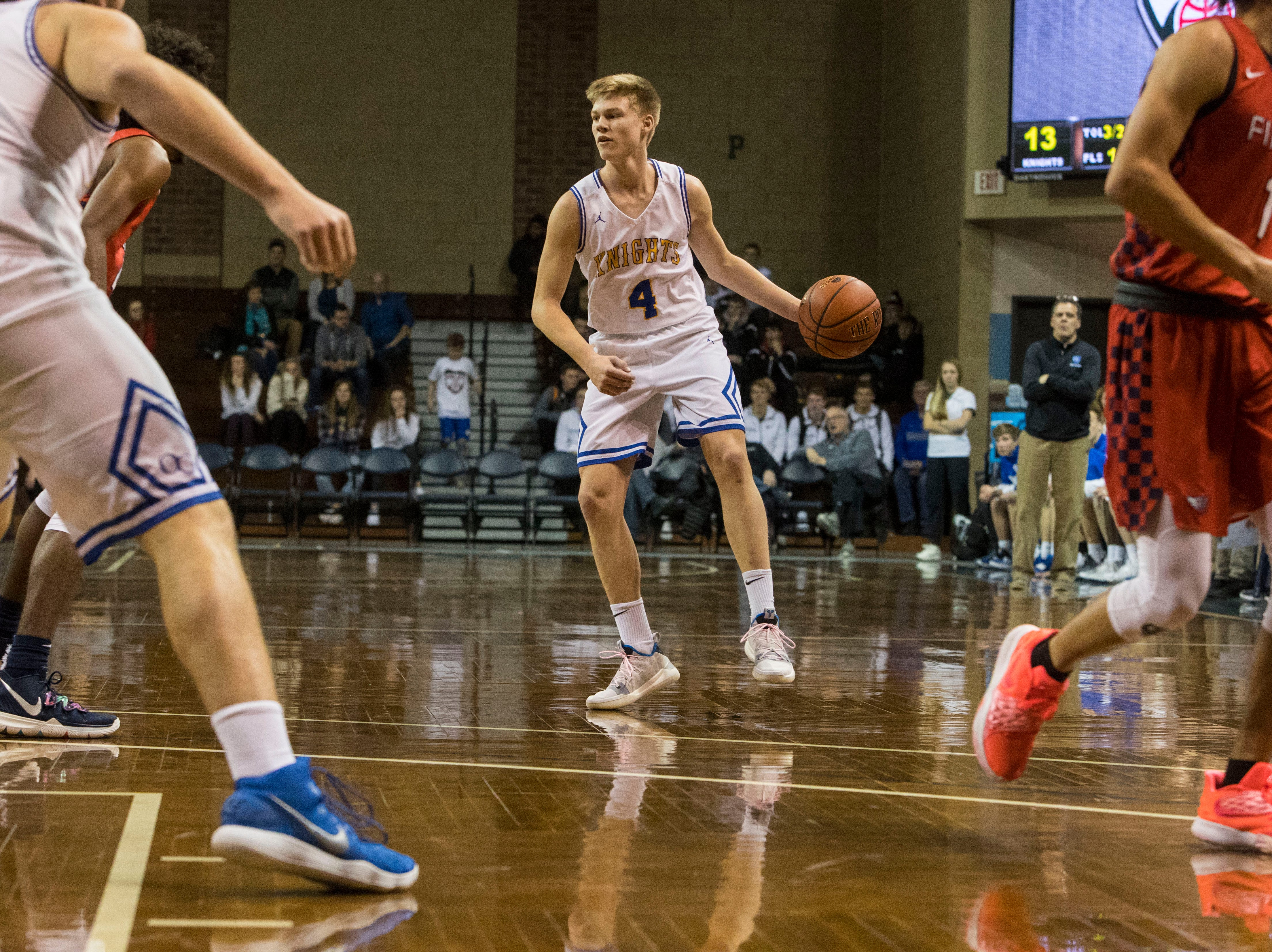 O'Gorman's Luke Ronsiek (4) dribbles the ball during a game against Findlay Prep at the Hoop City Classic at the Sanford Pentagon in Sioux Falls, S.D., Saturday, Dec. 29, 2018.