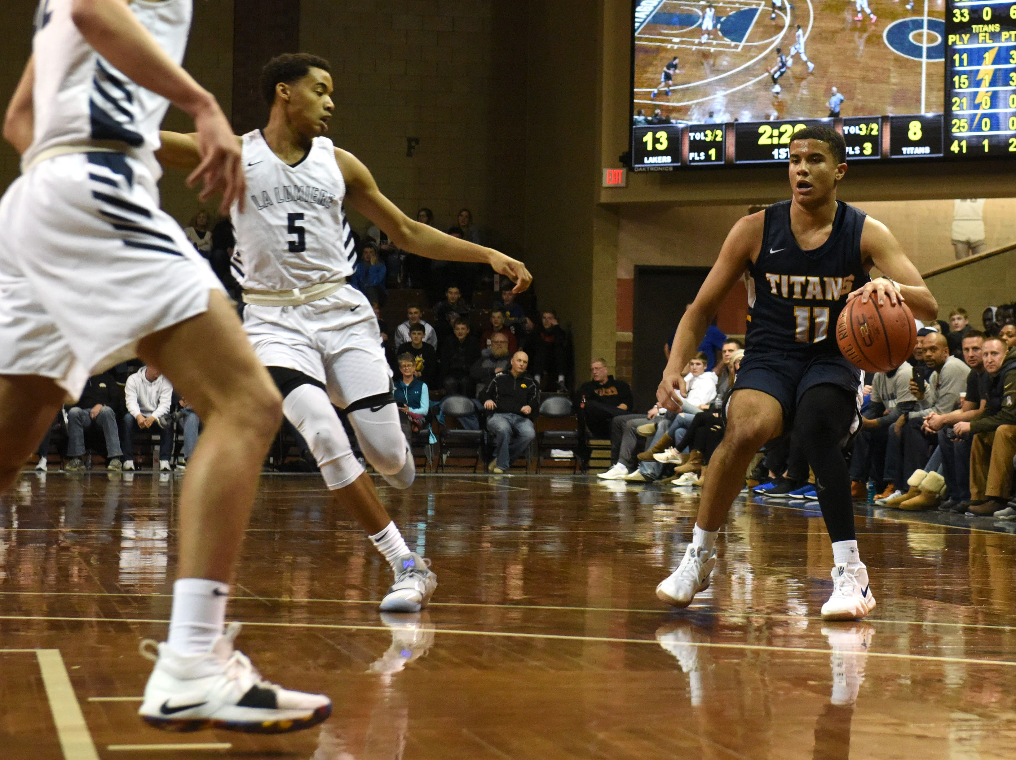 Tea's Justin Hohn (11) dribbles the ball during a game against La Lumiere at the Hoop City Classic at the Sanford Pentagon in Sioux Falls, S.D., Saturday, Dec. 29, 2018.