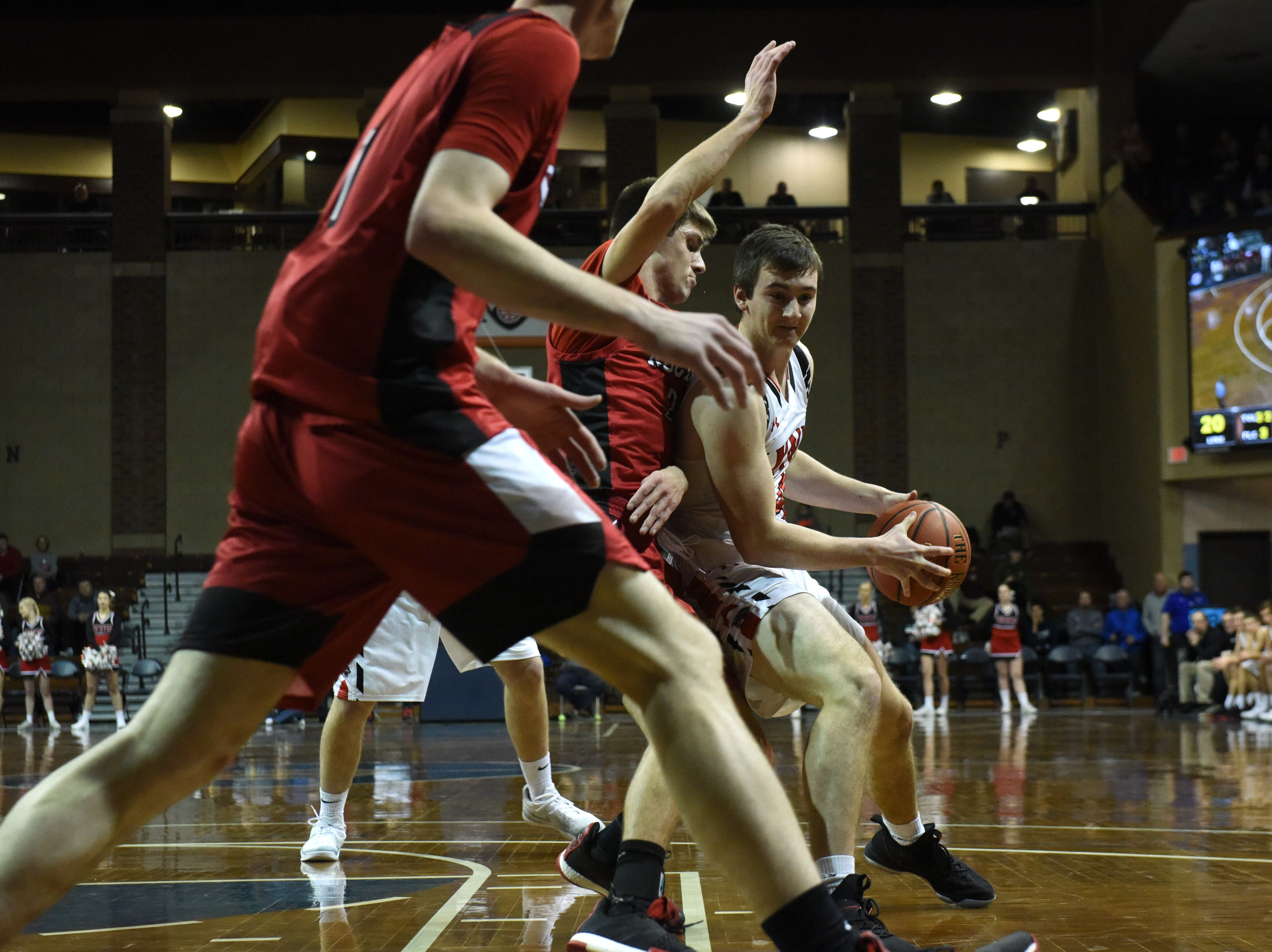 Brandon Valley's Cole Siegfried (14) dribbles the ball during a game against John Marshall at the Hoop City Classic at the Sanford Pentagon in Sioux Falls, S.D., Saturday, Dec. 29, 2018.