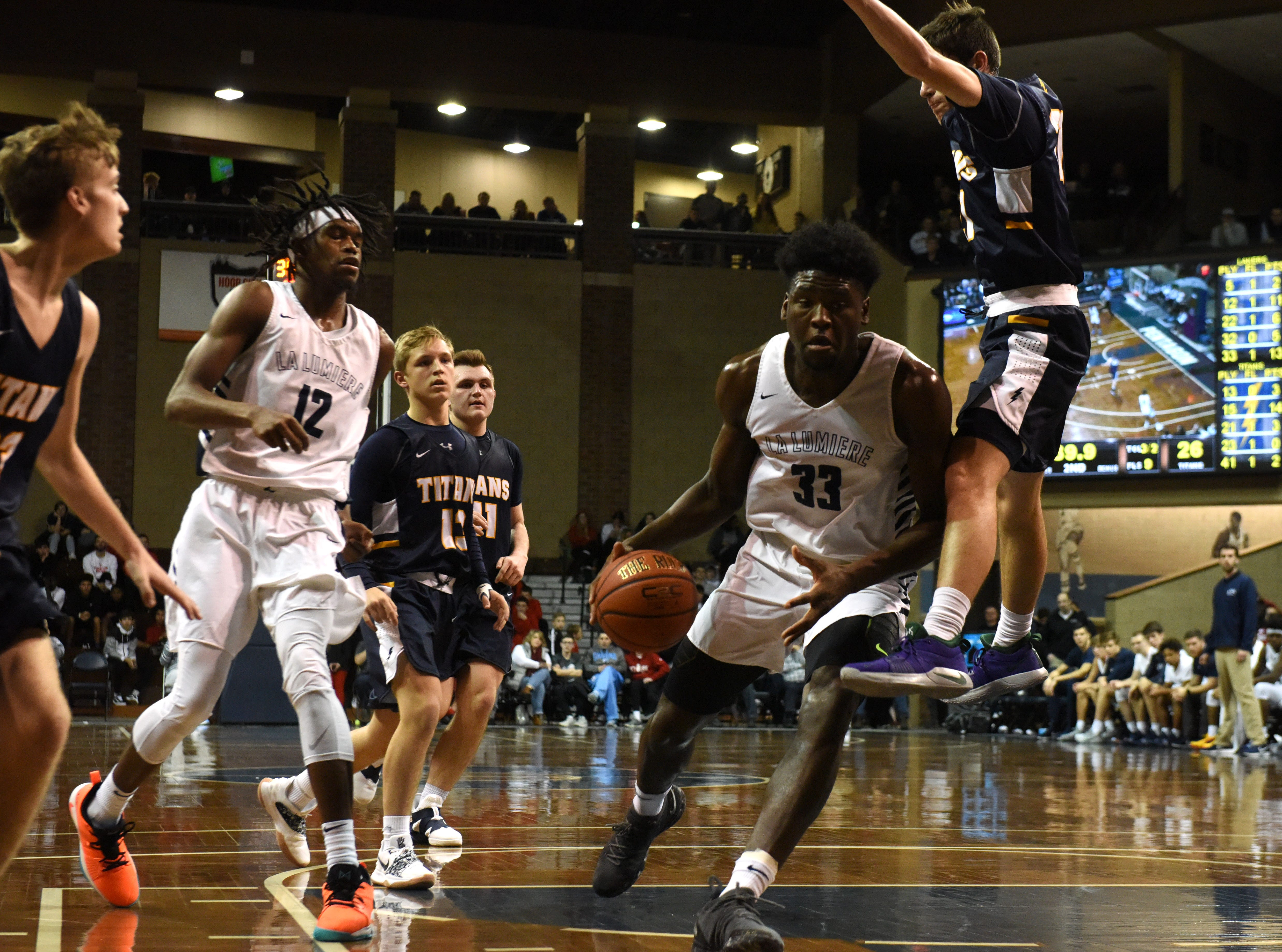 La Lumiere's Isaiah Stewart (33) dribbles the ball during a game against Tea at the Hoop City Classic at the Sanford Pentagon in Sioux Falls, S.D., Saturday, Dec. 29, 2018.