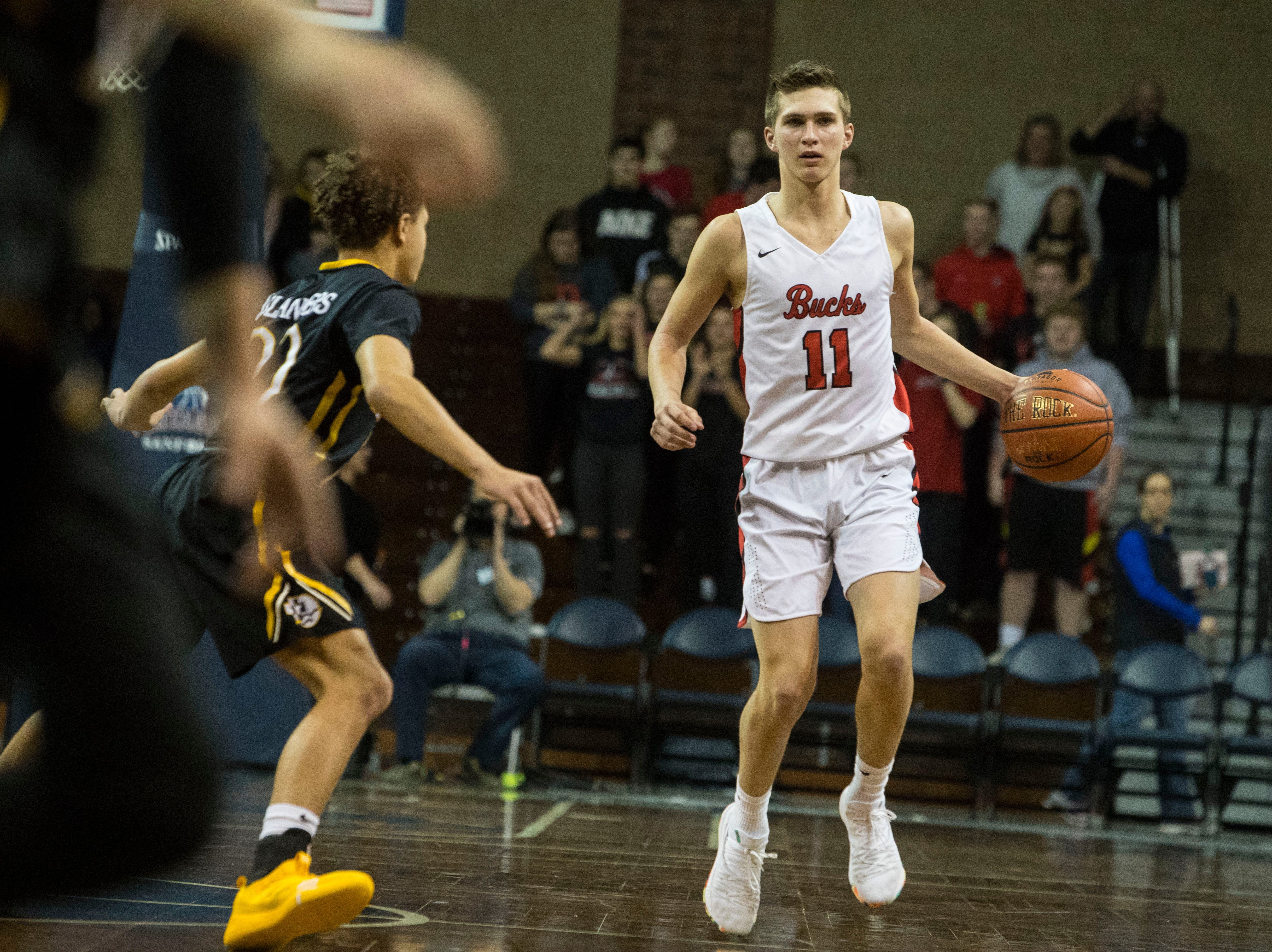 Yankton's Cooper Cornemann (11) dribbles the ball during a game against DeLaSalle at the Hoop City Classic at the Sanford Pentagon in Sioux Falls, S.D., Saturday, Dec. 29, 2018.