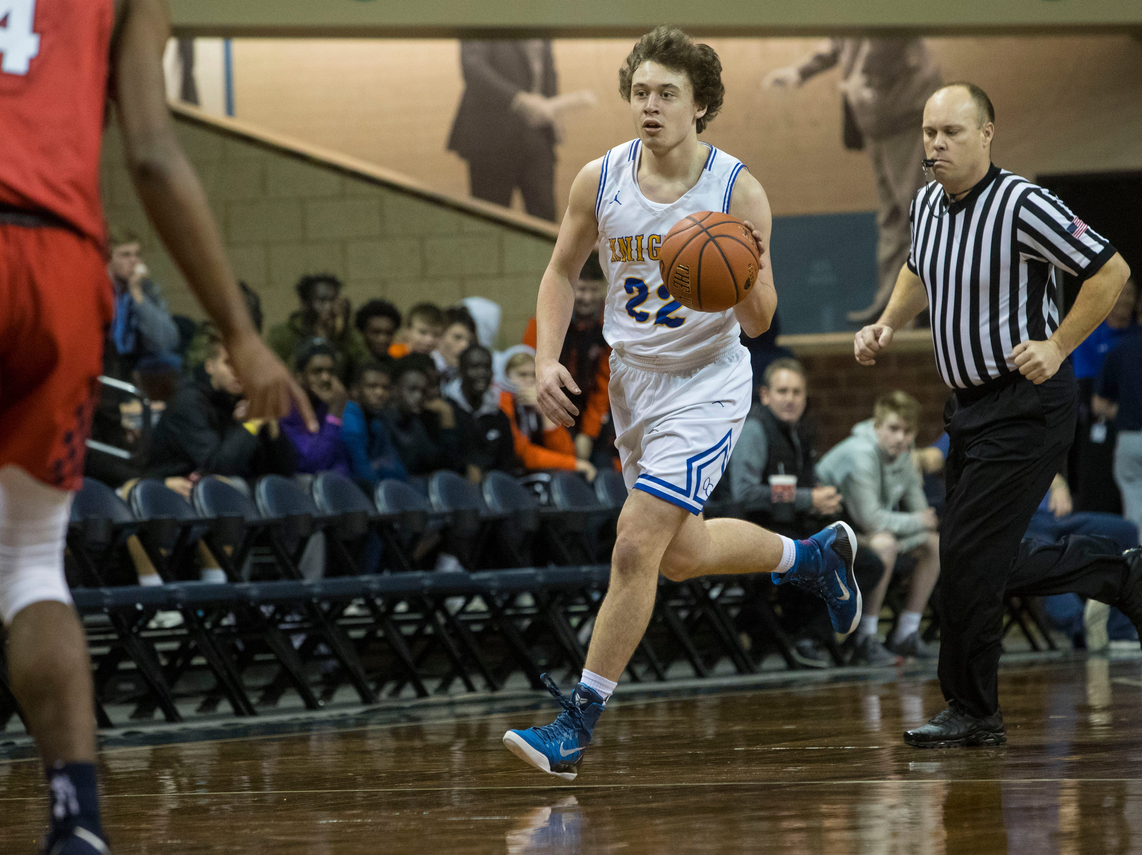 O'Gorman's Jeremy Jones (22) dribbles the ball during a game against Findlay Prep at the Hoop City Classic at the Sanford Pentagon in Sioux Falls, S.D., Saturday, Dec. 29, 2018.
