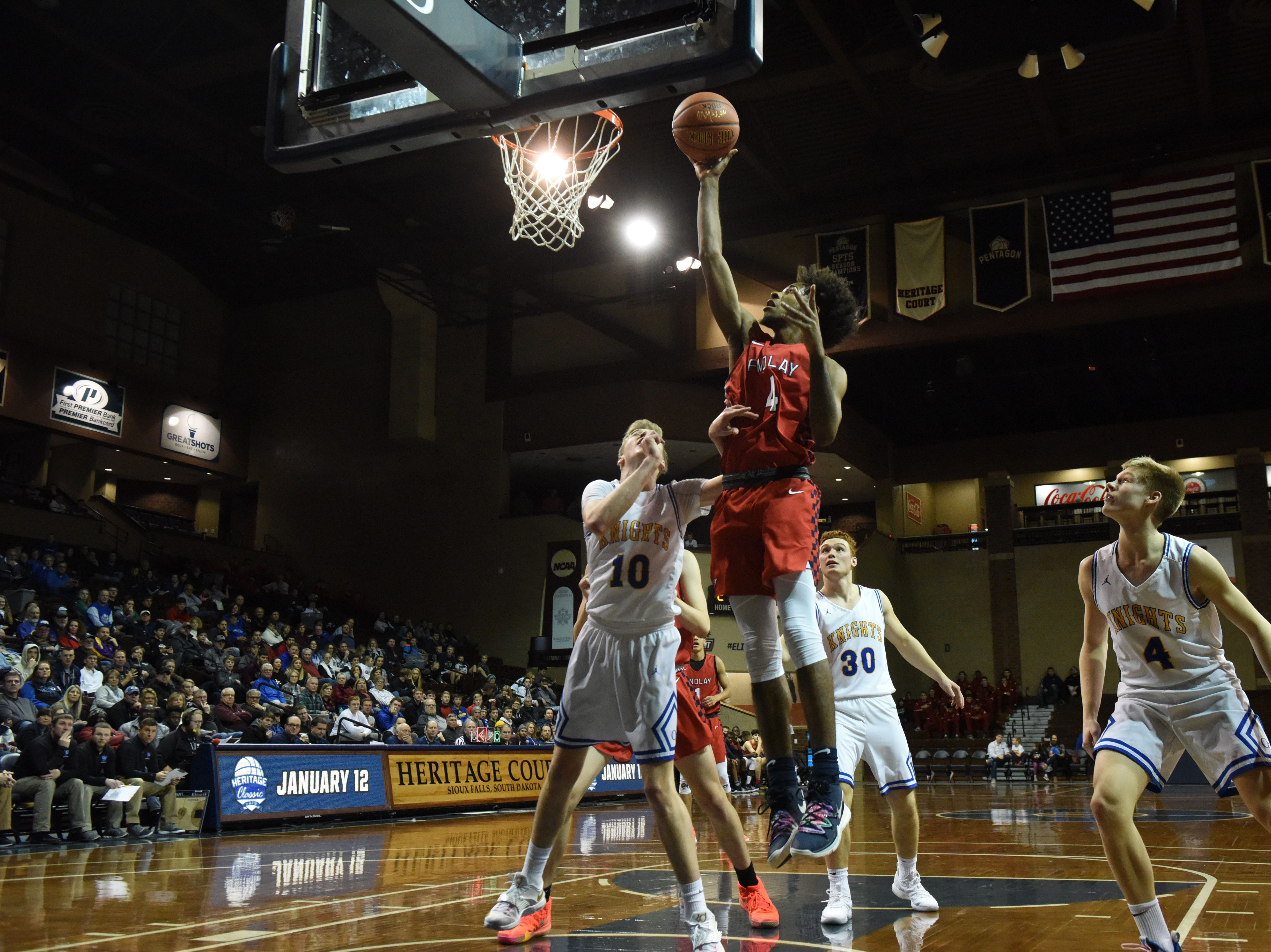 Findlay Prep's PJ Fuller (4) goes up for a shot during a game against O'Gorman at the Hoop City Classic at the Sanford Pentagon in Sioux Falls, S.D., Saturday, Dec. 29, 2018.