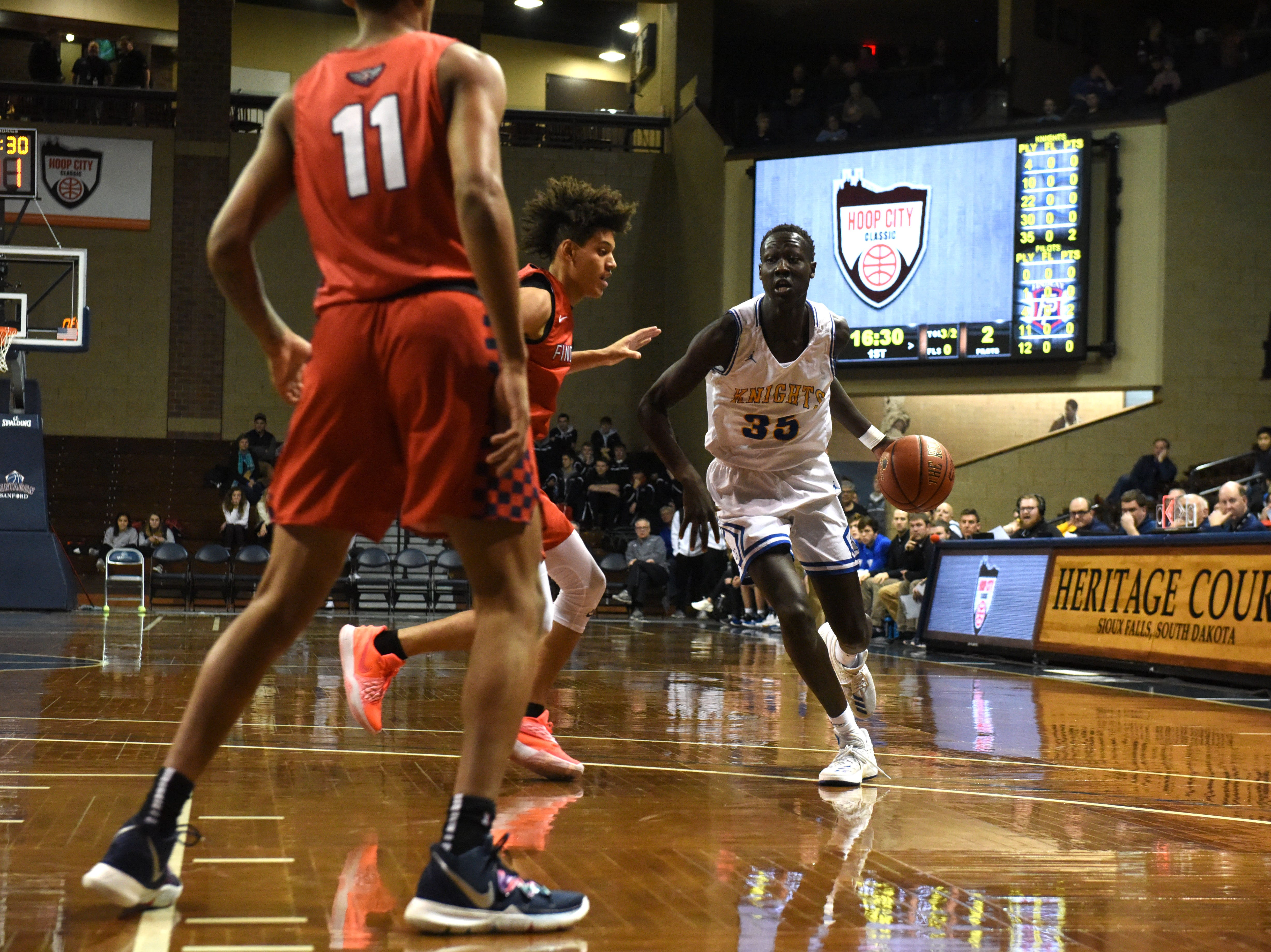 O'Gorman's Akoi Akoi (35) dribbles the ball past Findlay Prep players at the Hoop City Classic at the Sanford Pentagon in Sioux Falls, S.D., Saturday, Dec. 29, 2018.