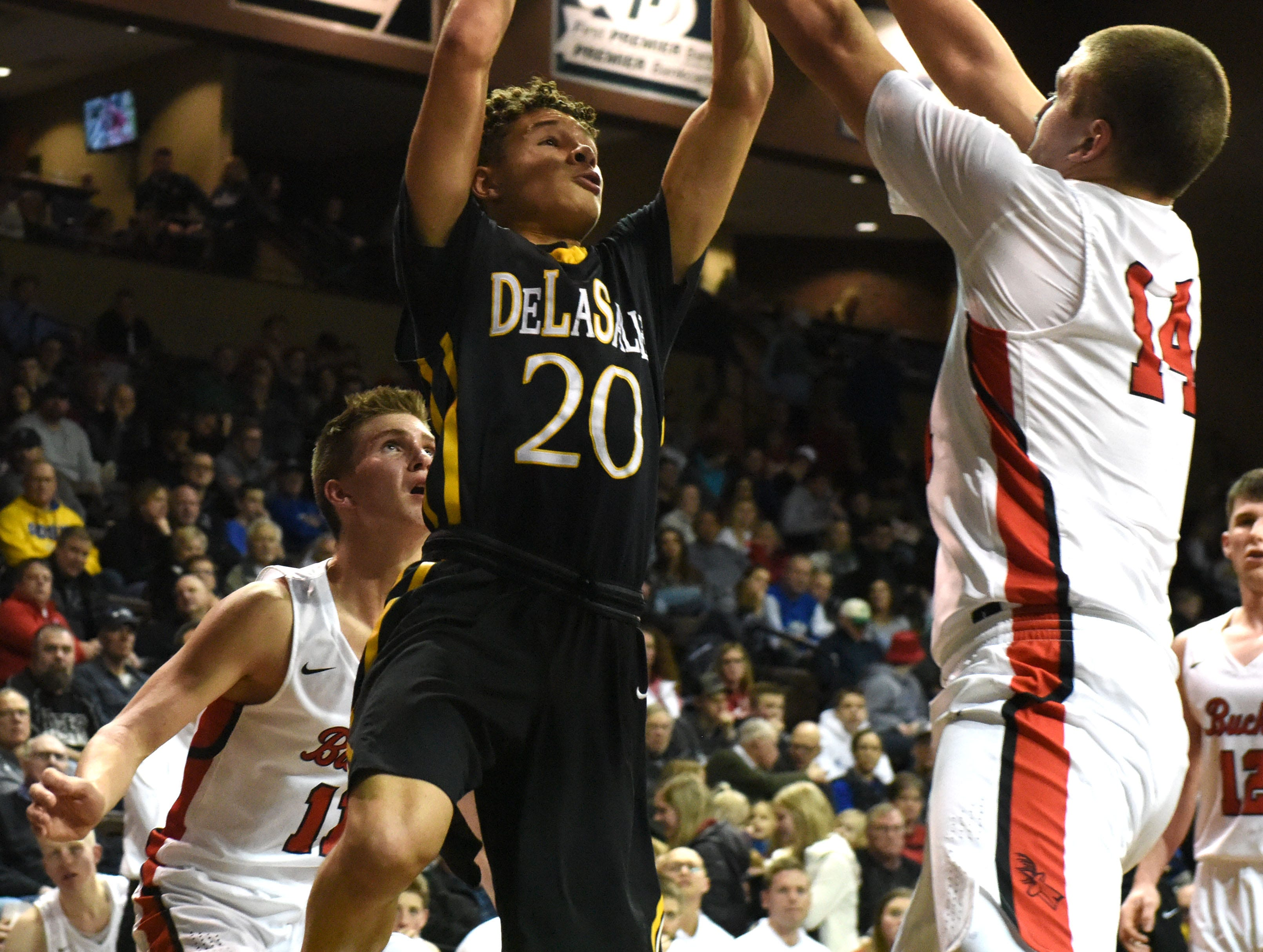 DeLaSalle's Andrew Irvin (20) shoots the ball during a game against Yankton at the Hoop City Classic at the Sanford Pentagon in Sioux Falls, S.D., Saturday, Dec. 29, 2018.