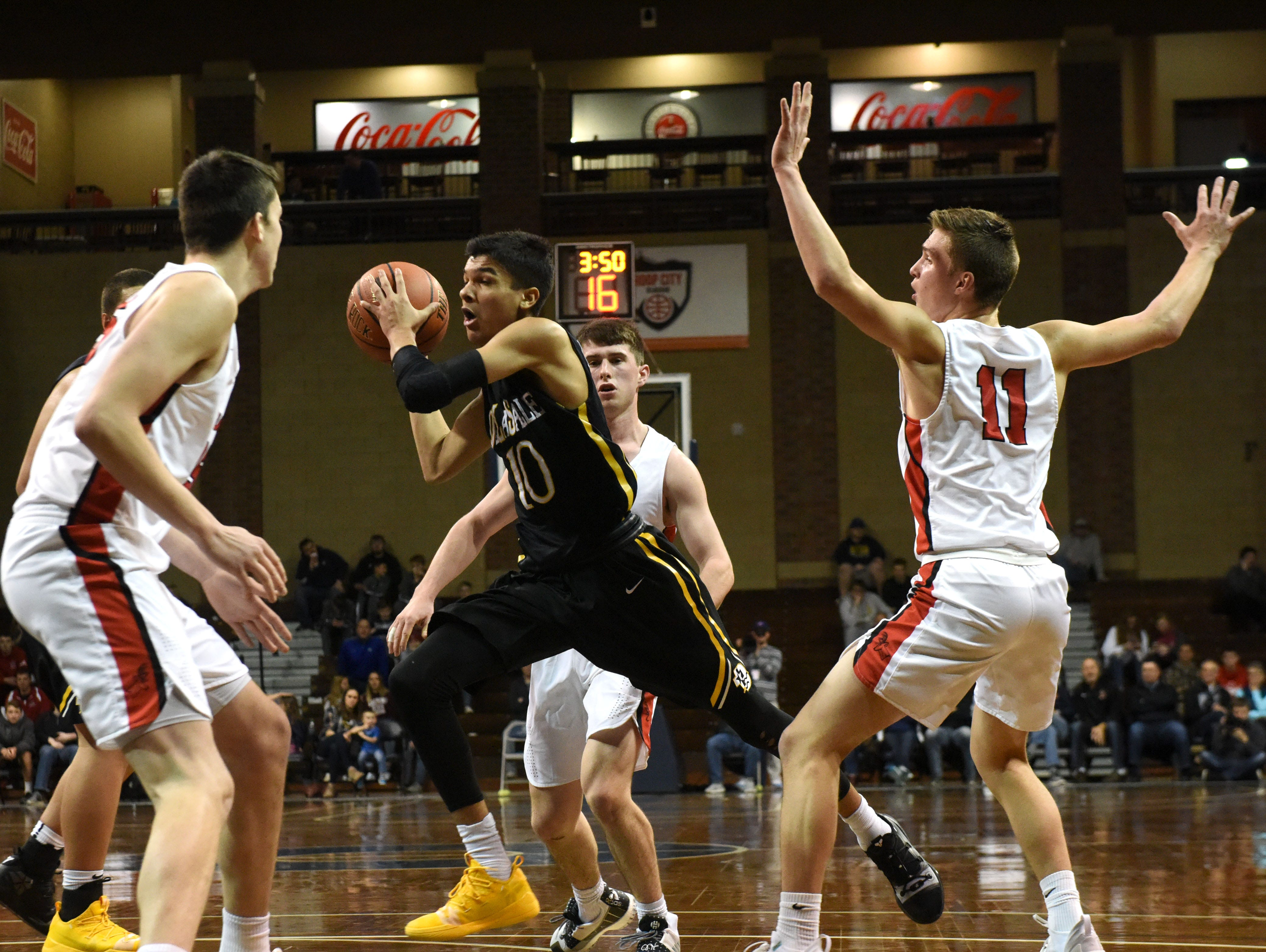 Delasalle's Tyrell Terry (10) dribbles the ball past Yankton players at the Hoop City Classic at the Sanford Pentagon in Sioux Falls, S.D., Saturday, Dec. 29, 2018.