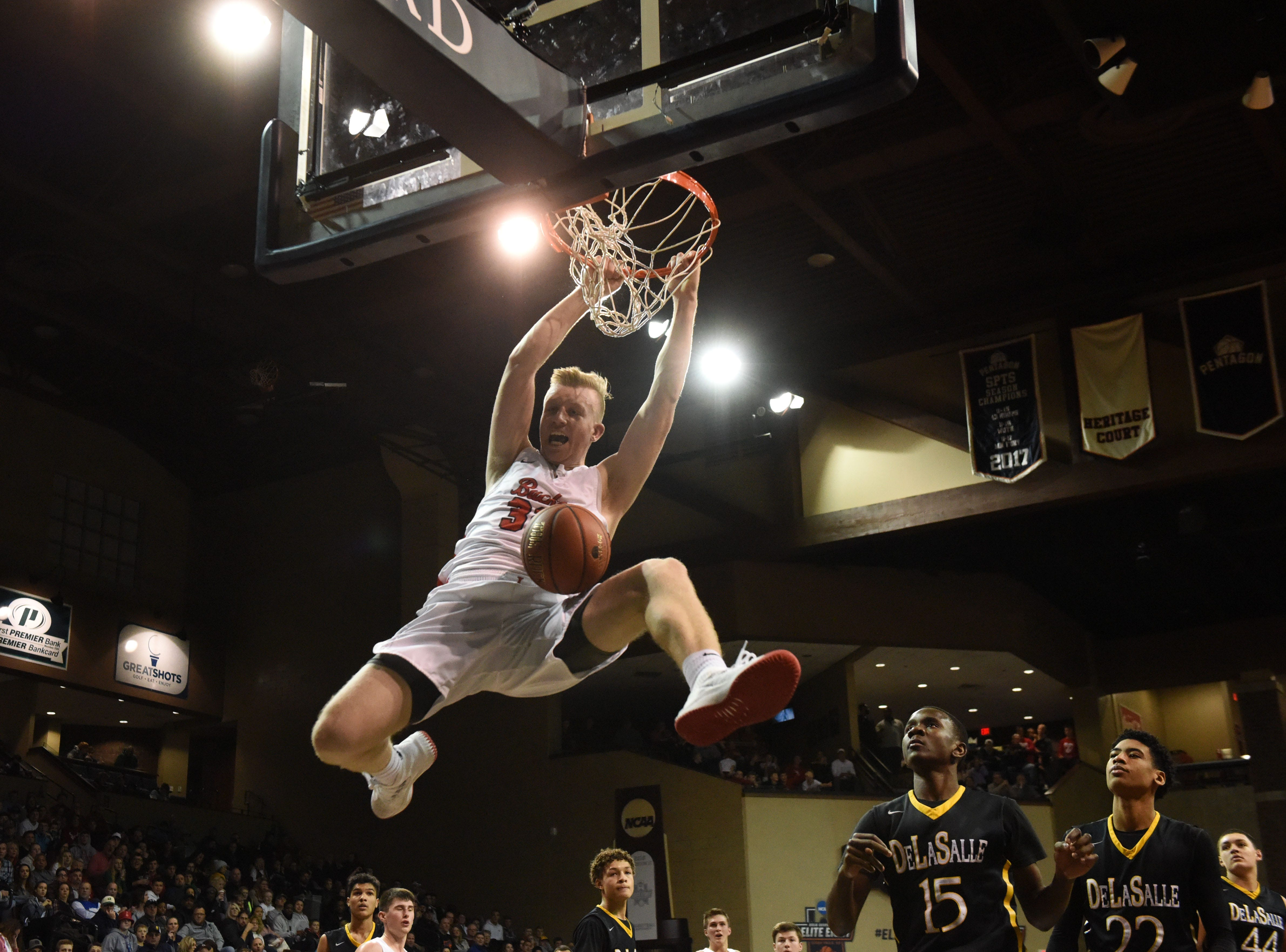Yankton's Matthew Mors (32) slams home a dunk during a game against DeLaSalle at the Hoop City Classic at the Sanford Pentagon in Sioux Falls, S.D., Saturday, Dec. 29, 2018.