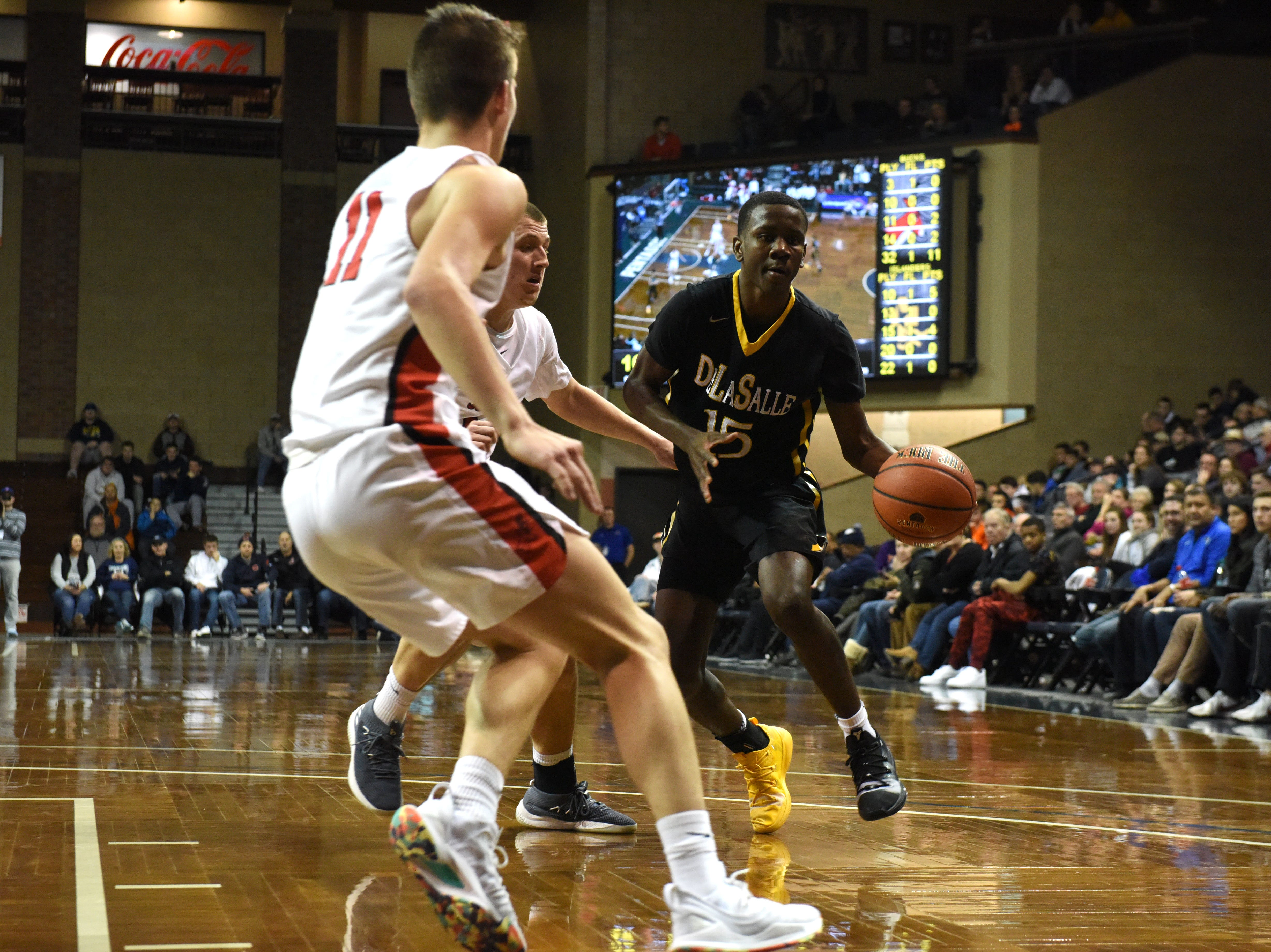 DeLaSalle's Edward Reed (15) dribbles the ball past Yankton players at the Hoop City Classic at the Sanford Pentagon in Sioux Falls, S.D., Saturday, Dec. 29, 2018.