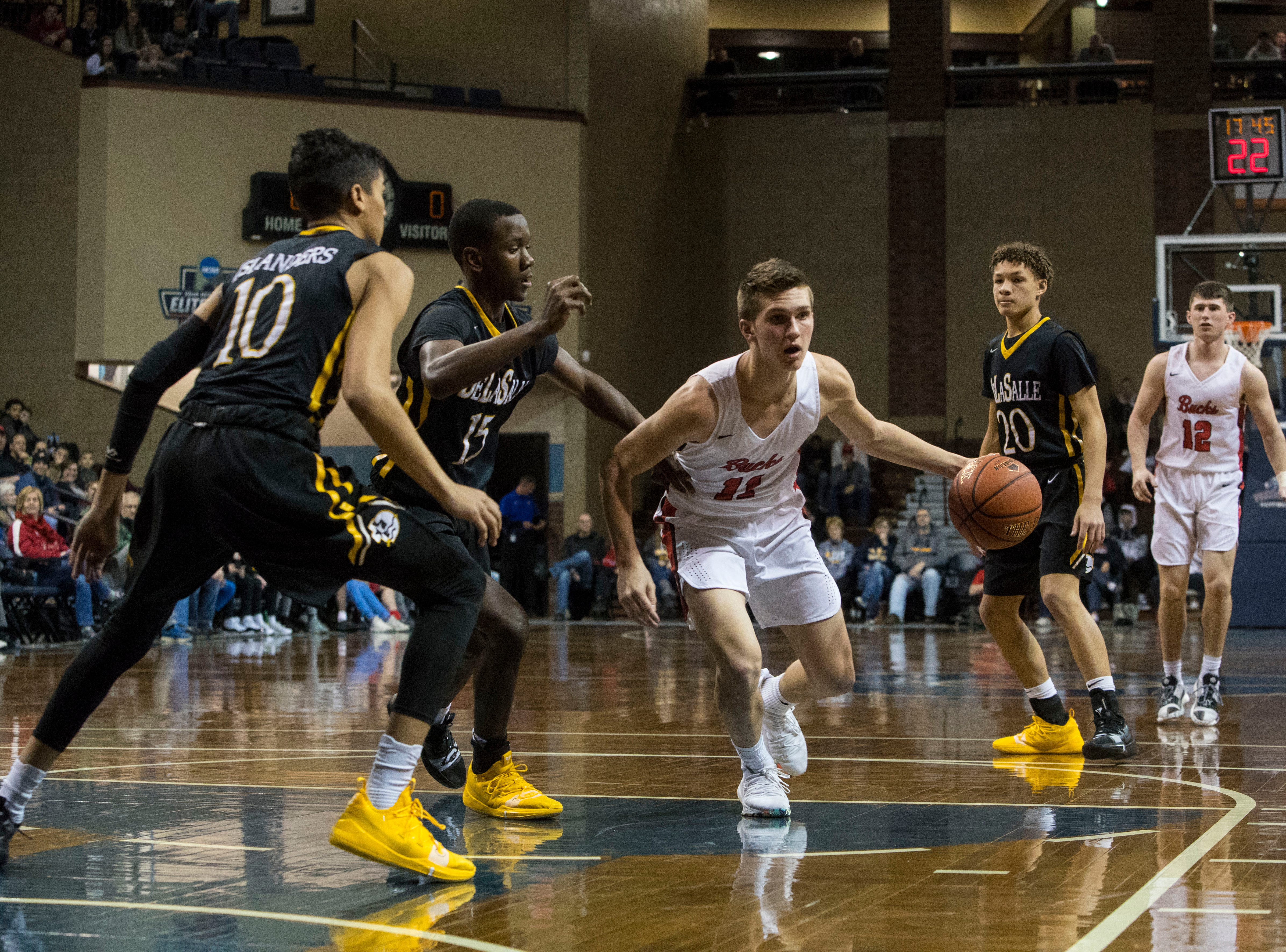 Yankton's Cooper Cornemann (11) dribbles the ball past DeLaSalle players at the Hoop City Classic at the Sanford Pentagon in Sioux Falls, S.D., Saturday, Dec. 29, 2018.