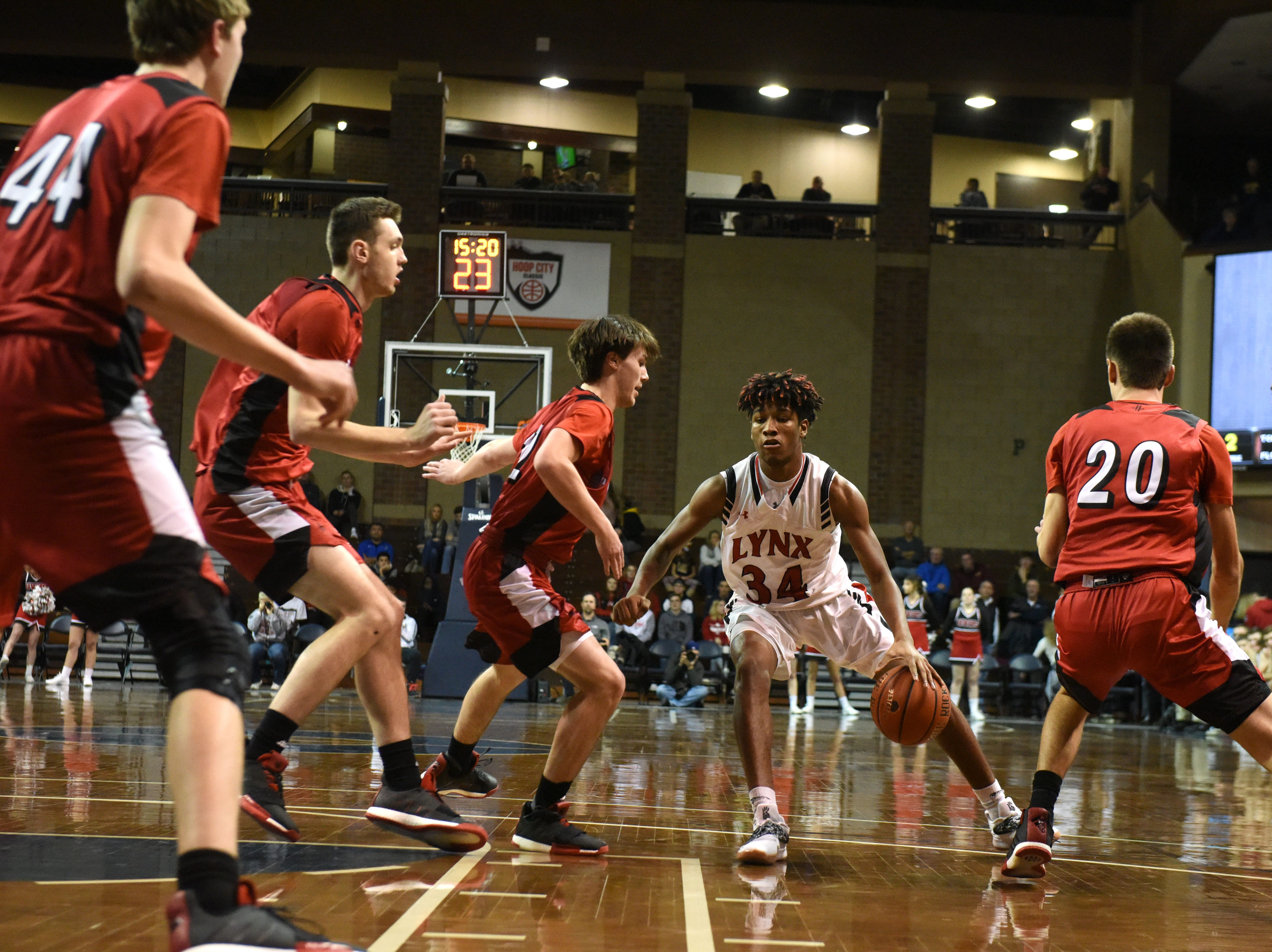 Brandon Valley's Jackson Hilton (34) dribbles the ball during a game against John Marshall at the Hoop City Classic at the Sanford Pentagon in Sioux Falls, S.D., Saturday, Dec. 29, 2018.