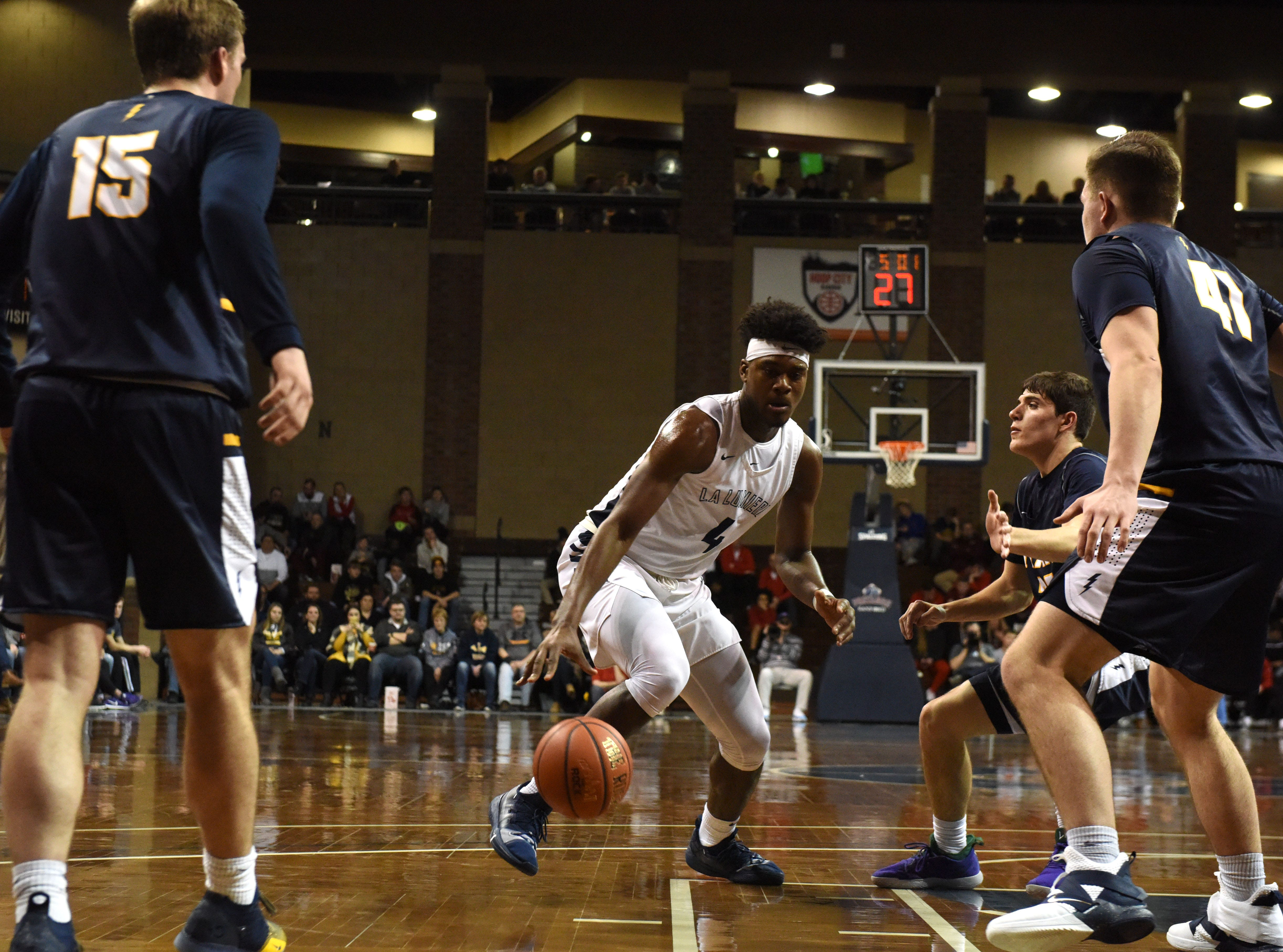 La Lumiere's Gerald Drumgoole (4) dribbles the ball during a game against Tea at the Hoop City Classic at the Sanford Pentagon in Sioux Falls, S.D., Saturday, Dec. 29, 2018.