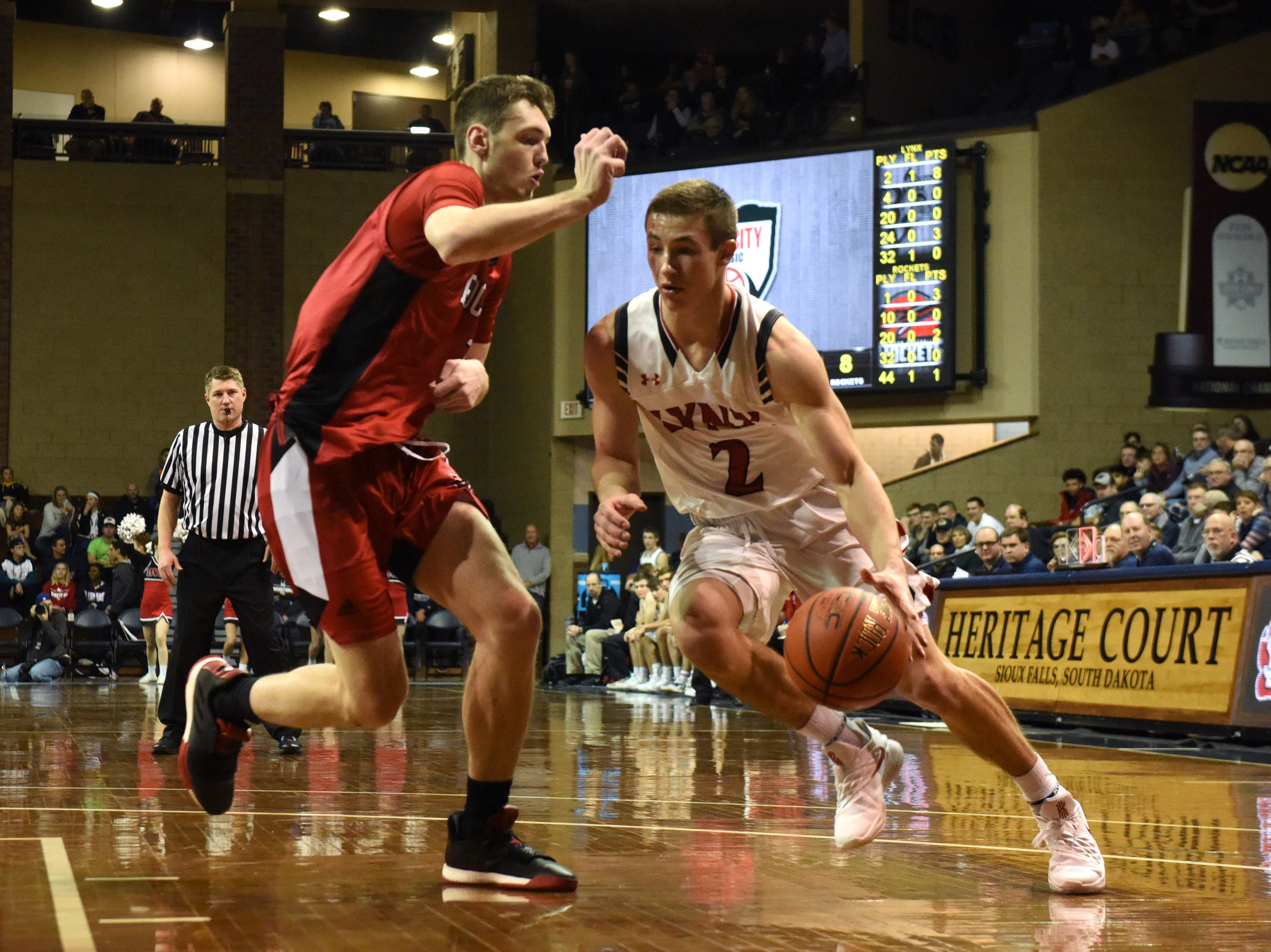 Brandon Valley's Carter Olthoff (2) dribbles the ball past John Marshall's Matthew Hurt (1) at the Hoop City Classic at the Sanford Pentagon in Sioux Falls, S.D., Saturday, Dec. 29, 2018.