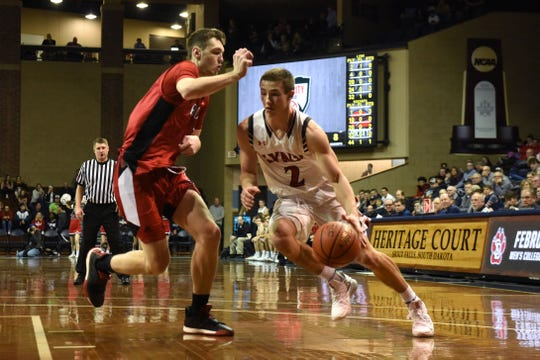 Brandon Valley's Carter Olthoff (2) dribbles the ball past John Marshall's Matthew Hurt (1) at the Hoop City Classic at the Sanford Pentagon in Sioux Falls, S.D., Saturday, Dec. 29, 2018. The Lynx have now won five straight to improve to 6-2 on the season.
