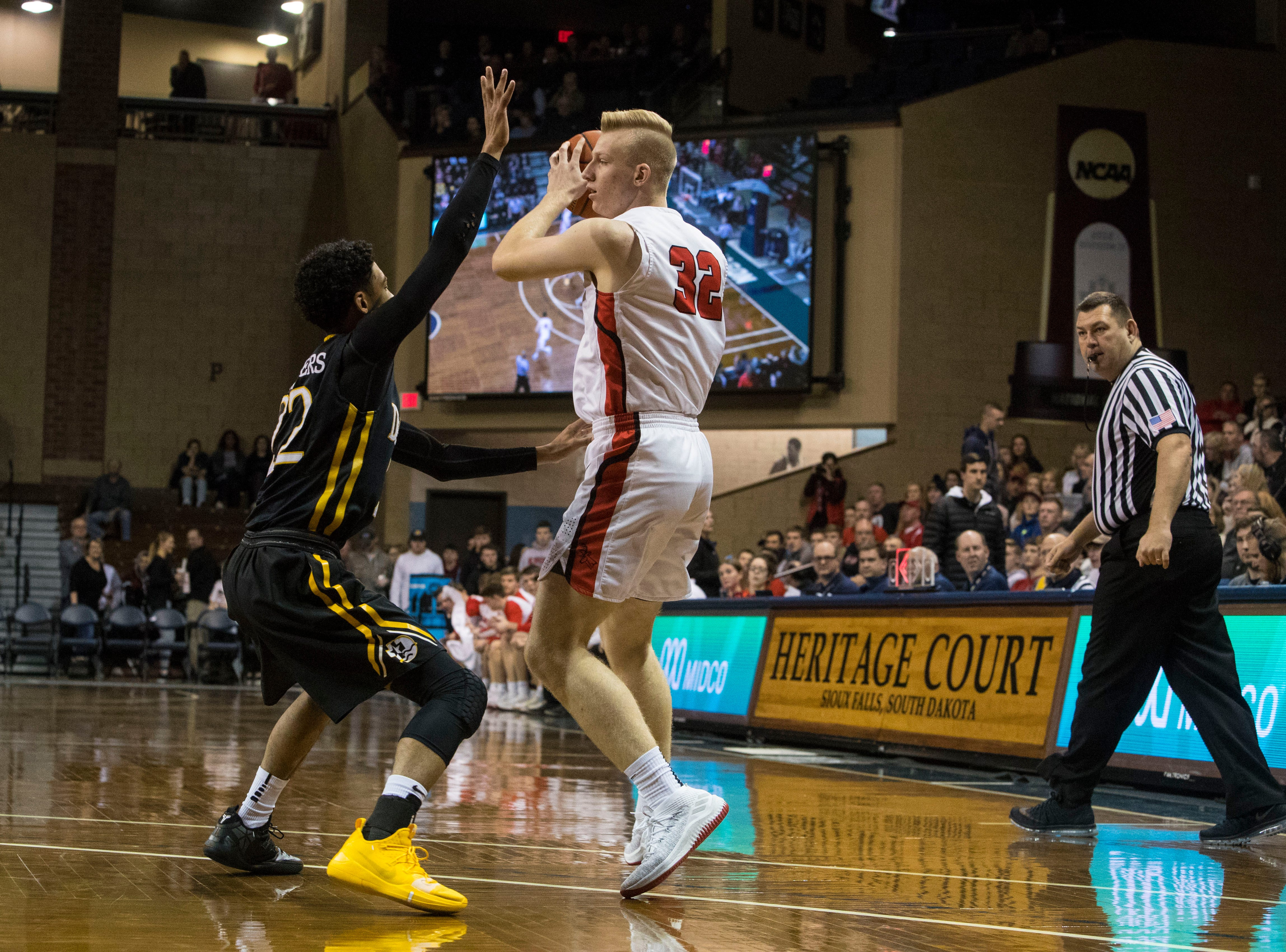 Yankton's Matthew Mors (32) looks to pass the ball during a game against DeLaSalle at the Hoop City Classic at the Sanford Pentagon in Sioux Falls, S.D., Saturday, Dec. 29, 2018.