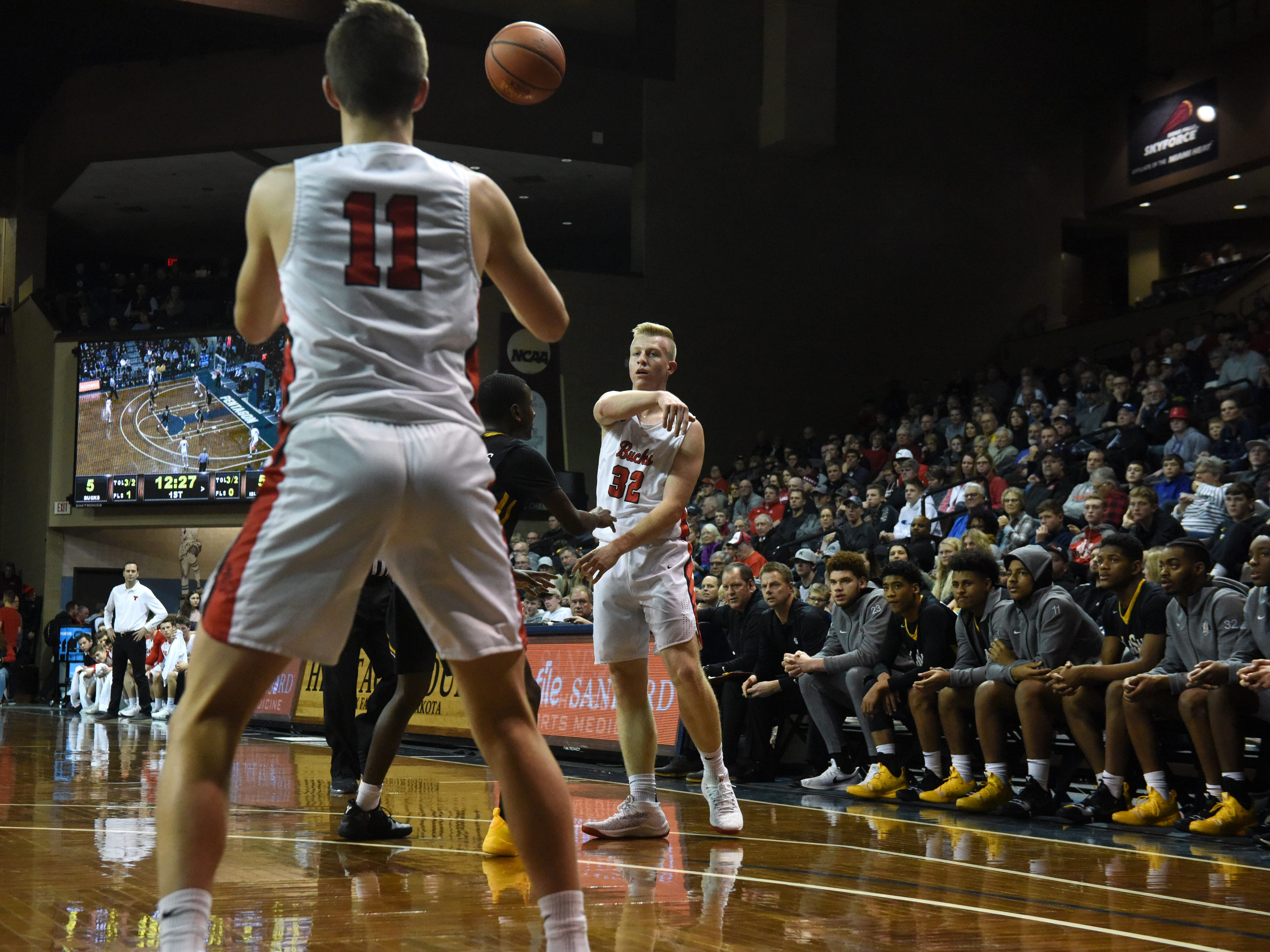 Yankton's Matthew Mors (32) passes the ball to Yankton's Cooper Cornemann (11) during a game against DeLaSalle at the Hoop City Classic at the Sanford Pentagon in Sioux Falls, S.D., Saturday, Dec. 29, 2018.
