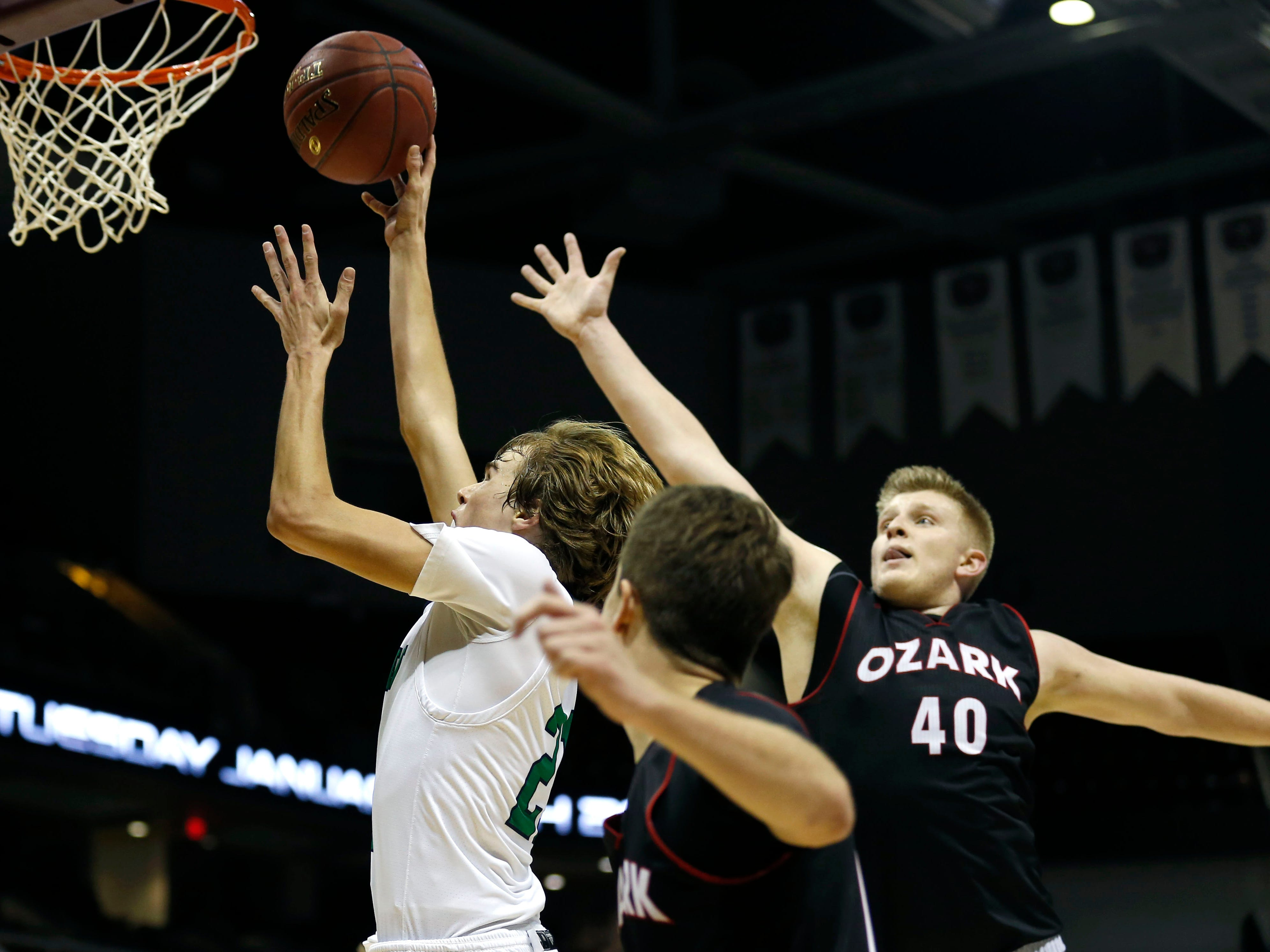 Catholic's Charlie O'Reilly take the ball to the basket during the Gold Division championship game against the Ozark Tigers during the 2018 Blue and Gold Tournament at JQH Arena on Saturday, Dec. 29, 2018.