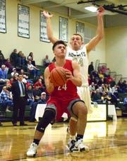 Riverheads' Grant Painter goes past Wilson Memorial's Jacob Sears on the way to the basket during the first half of their Shenandoah District boys basketball game on Saturday, Dec. 29, 2018, at Wilson Memorial High School in Fishersville, Va.