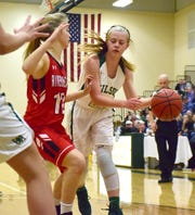 Wilson Memorial's Ashley Morani makes a pass around Riverheads' Savanna Crawford during the first half of their Shenandoah District girls basketball game on Saturday, Dec. 29, 2018, at Wilson Memorial High School in Fishersville, Va.