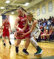 Riverheads' Dayton Moore, left, battles for the ball with Wilson Memorial's LeAnna Rankin during the first half of their Shenandoah District girls basketball game on Saturday, Dec. 29, 2018, at Wilson Memorial High School in Fishersville, Va.