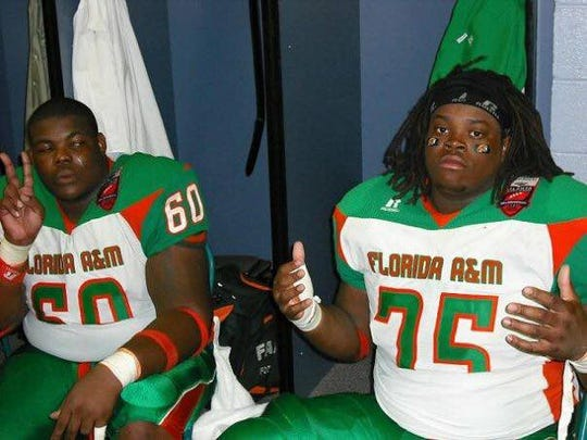 Former FAMU offensive lineman Anthony Collins (60) poses with Robert Okeafor in the locker room at the Atlanta Football Classic in 2008. The Rattlers posted a 28-14 win over Tennessee State.