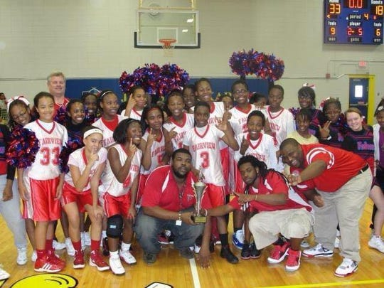 In 2013, Anthony Collins (center) led Fairview Middle School girls to a city championship in basketball.