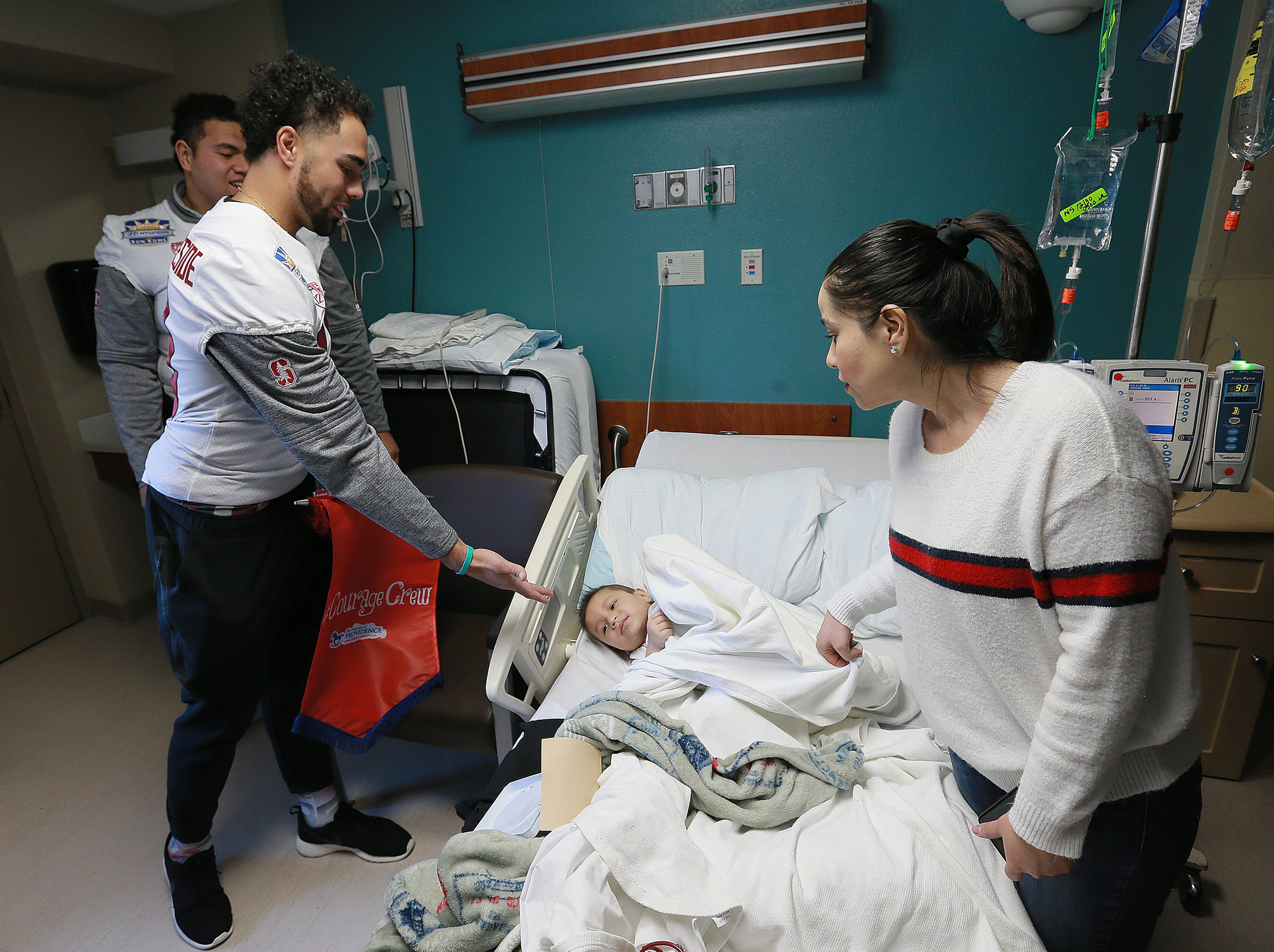 The Stanford football team visited children Sunday at Providence Children's Hospital as Pitt players visited El Paso Children's Hospital. The teams face off Monday in the 85th Hyundai Sun Bowl.