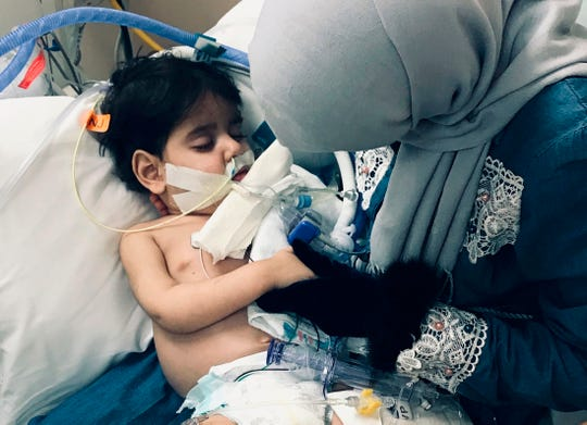 In this December 2018 photo released by the Council on American Islamic Relations, Sacramento Valley, Shaima Swileh, of Yemen, holds her dying 2-year old son Abdullah Hassan at UCSF Benioff Children's Hospital in Oakland.
