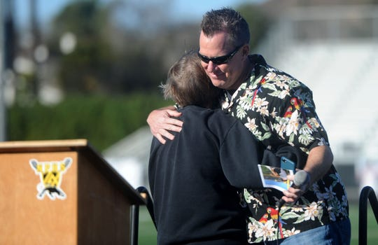 Berta Hurley, gets a hug from her son Ethan Hurley, during Saturday's tribute to George Hurley at Newbury Park High.