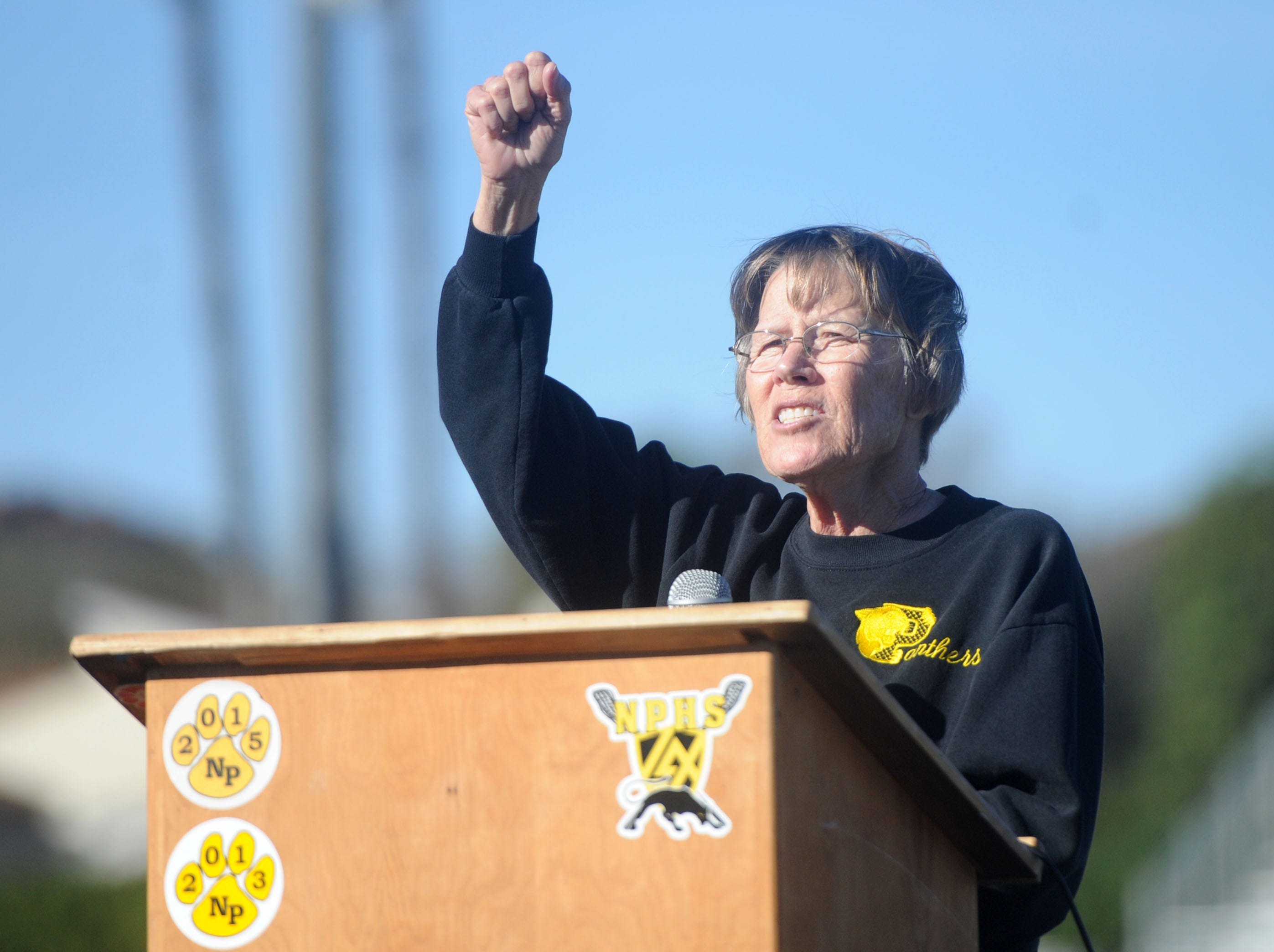 Berta Hurley, wife of George Hurley, speaks at the tribute for her husband Saturday at Newbury Park High.