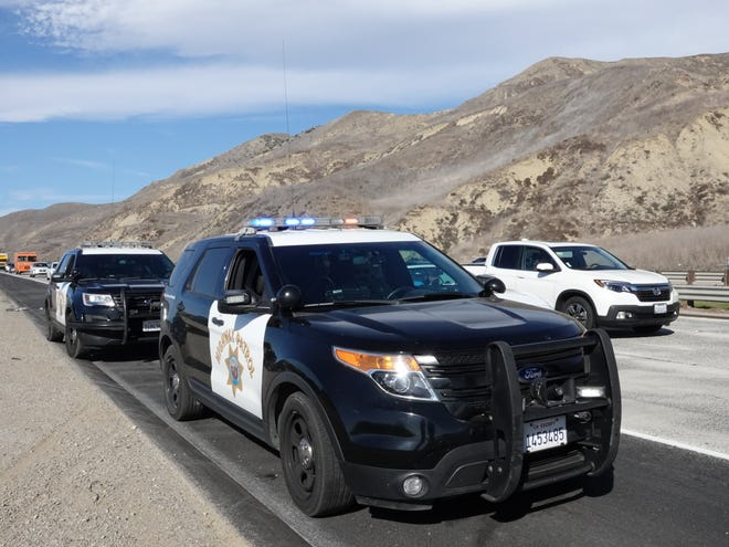 California Highway Patrol officers on southbound Highway 101, just north of Ventura, on Sunday. A fatal crash earlier had closed the freeway for hours.